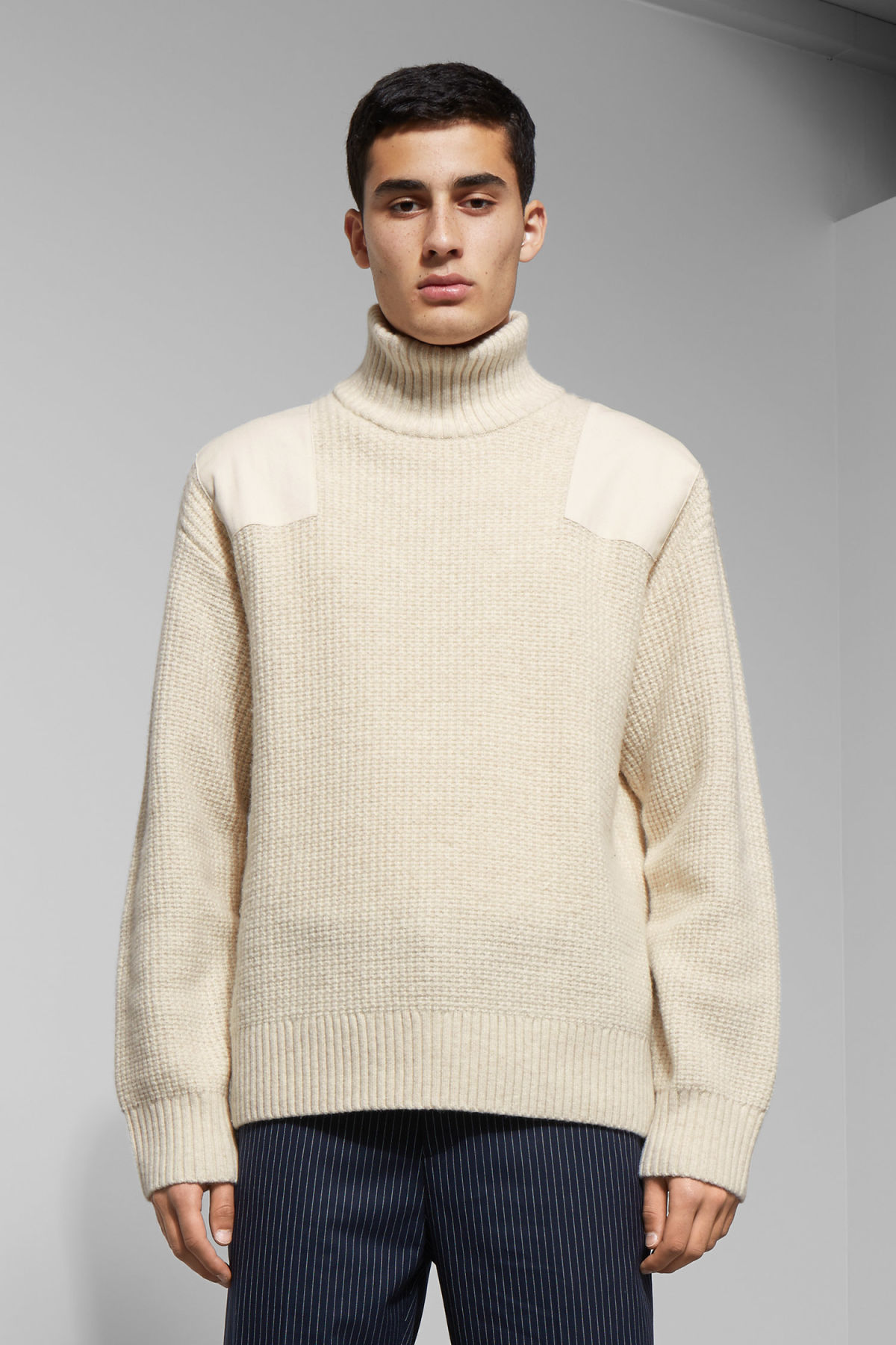 Model front image of Weekday haze turtleneck sweater in beige