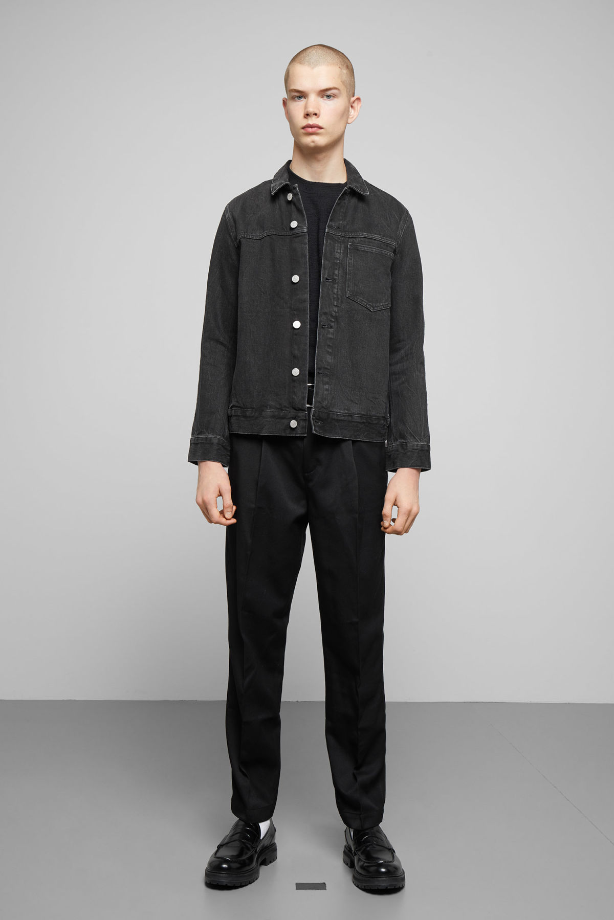 Model side image of Weekday core rodeo black jacket in black