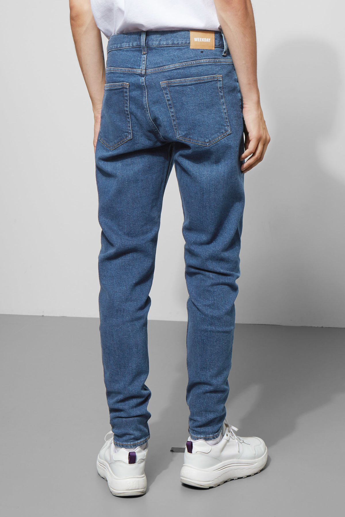 Model side image of Weekday cone gene blue jeans in blue