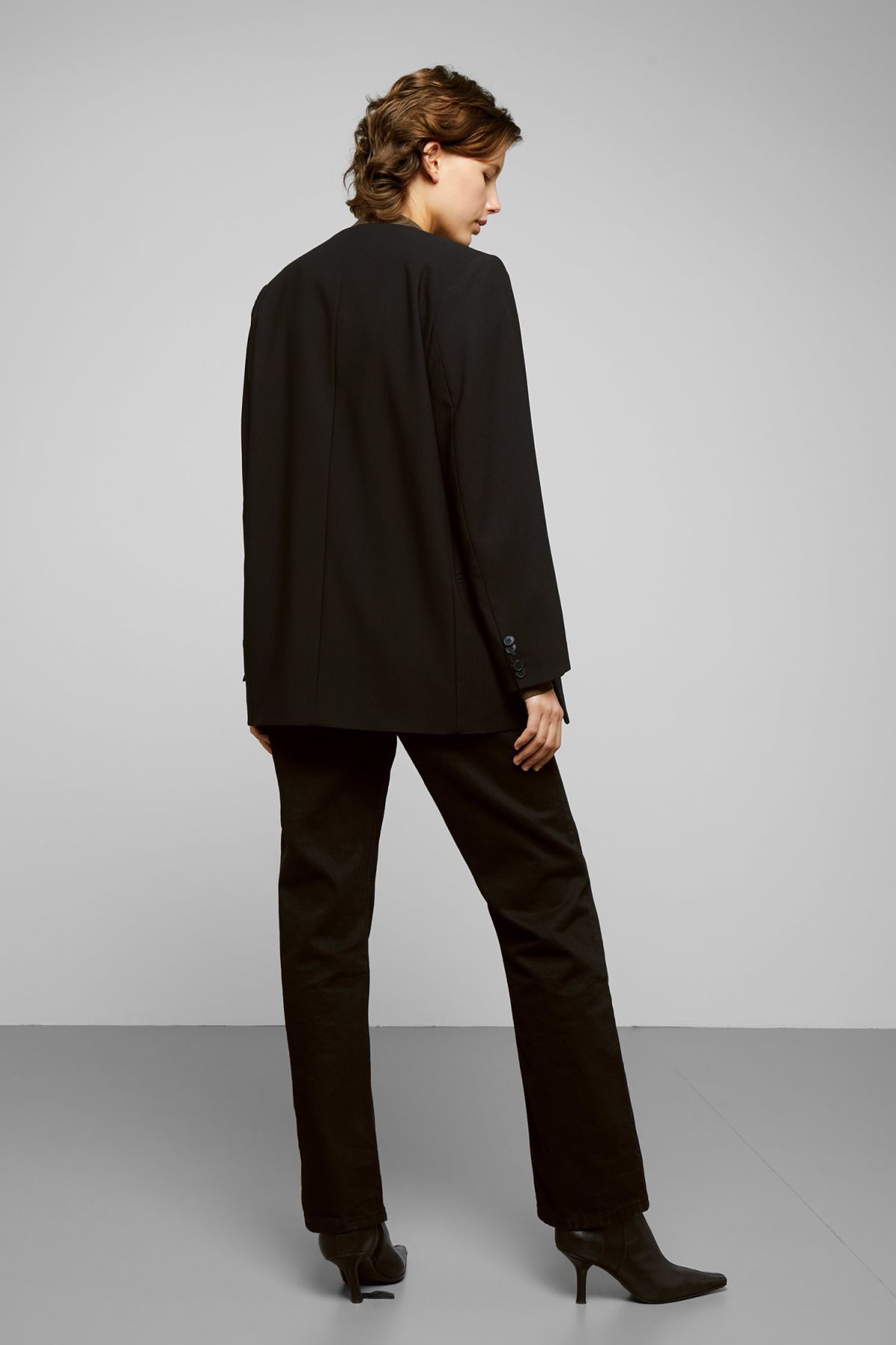 Model side image of Weekday jade blazer in black