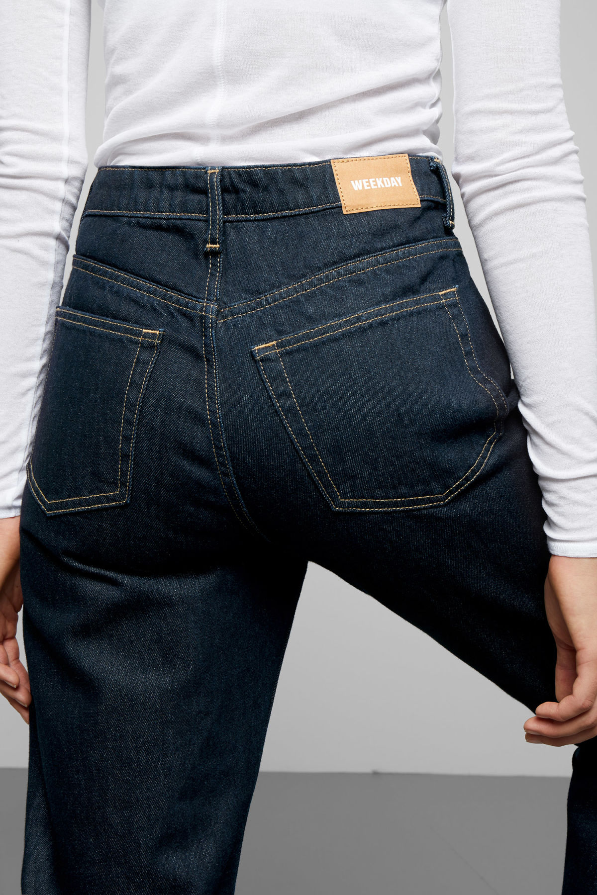 Model side image of Weekday lash soaked jeans in blue