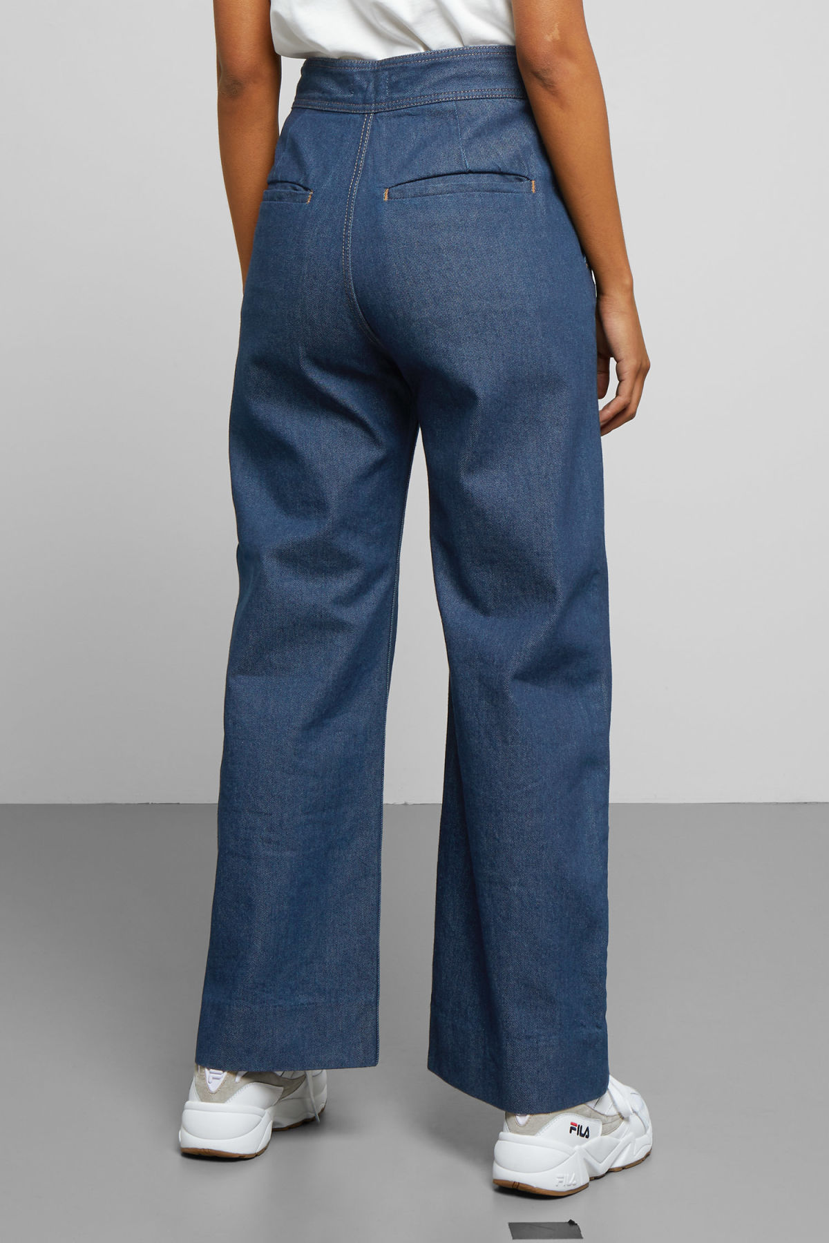 Model side image of Weekday cory denim trousers in blue