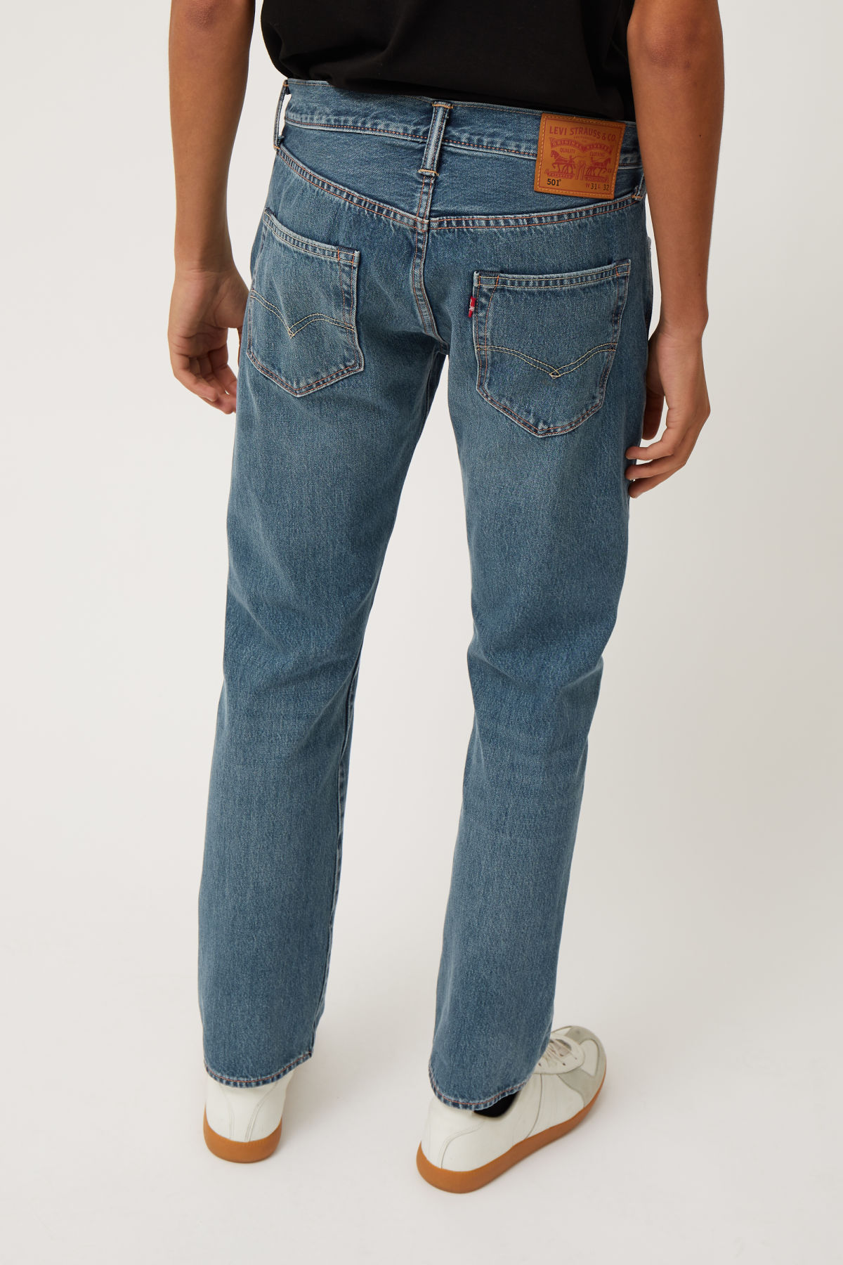 Model side image of Weekday 501 original electric ave jeans in blue