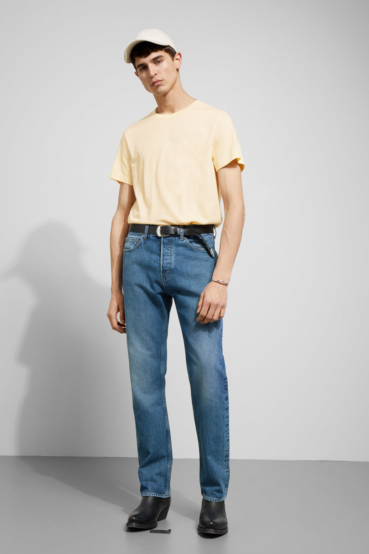 Model side image of Weekday pictor t-shirt in yellow