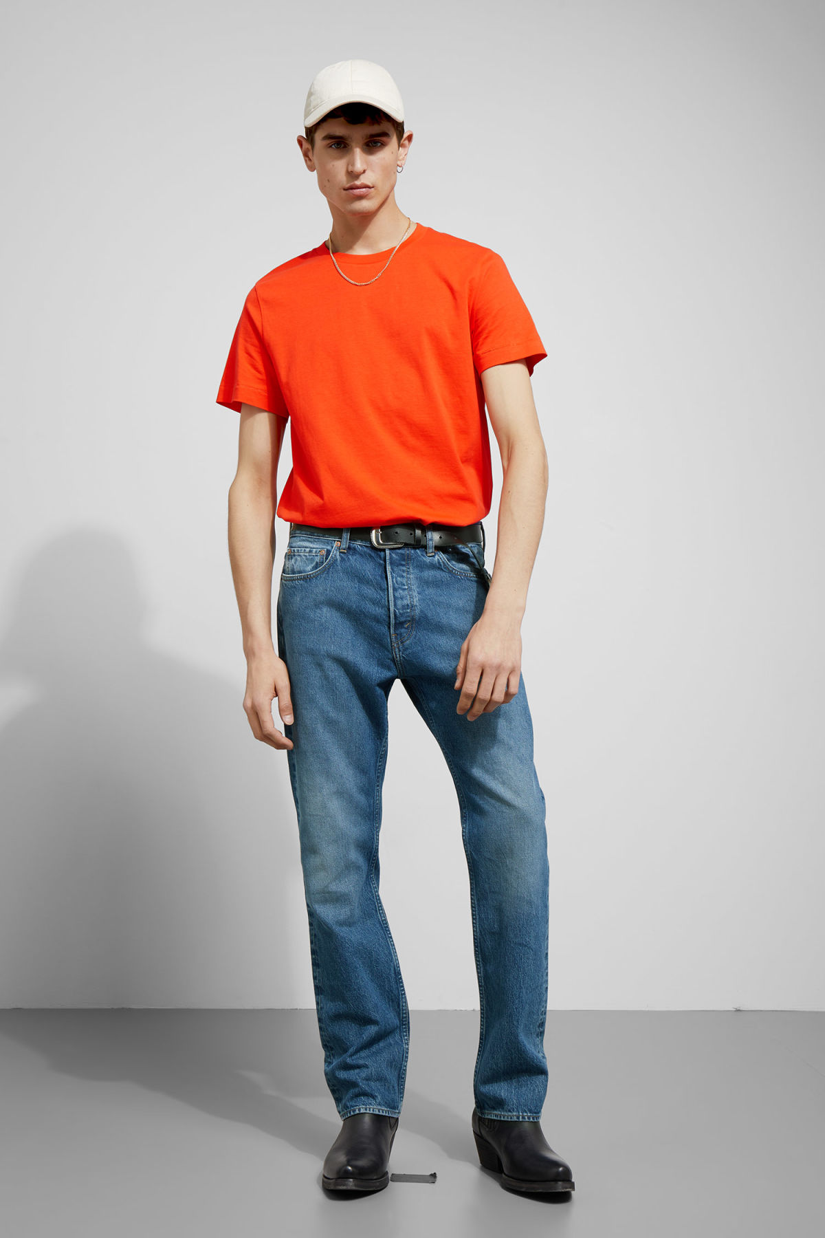 Model side image of Weekday pictor t-shirt in orange