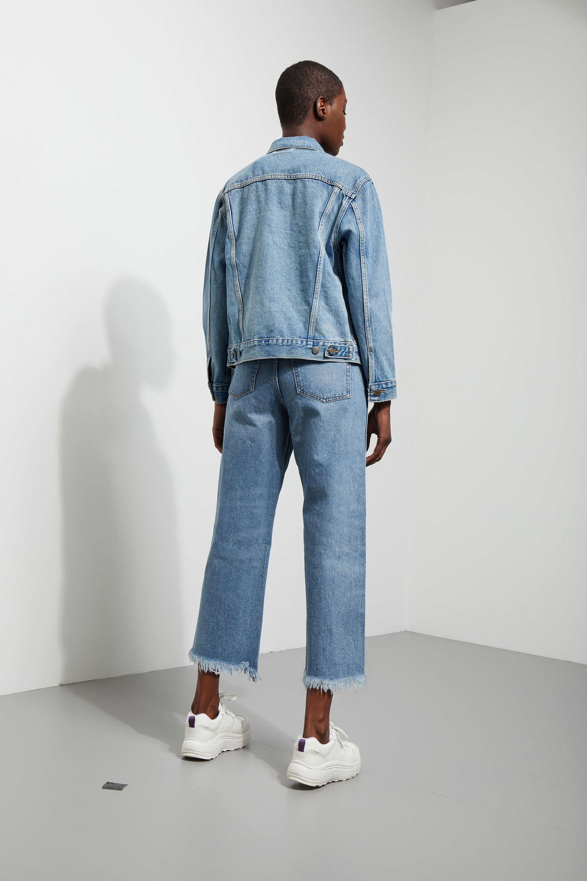 Model side image of Weekday ex-boyfriend trucker jacket in blue