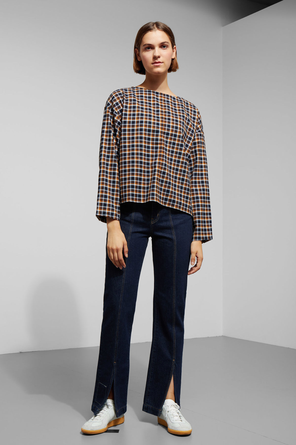 Model side image of Weekday sally check woven top in blue