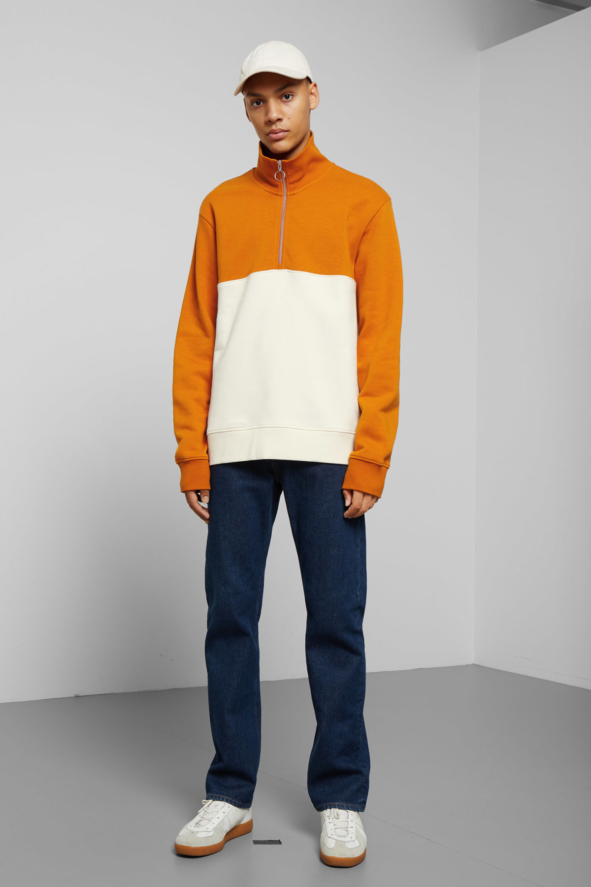 Model side image of Weekday martin blocked zip sweatshirt in white