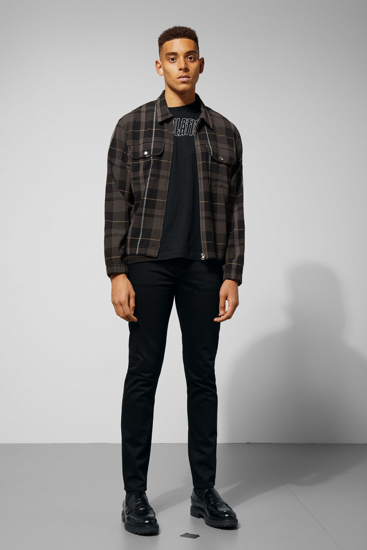 Model side image of Weekday ziggy zip checked shirt in black