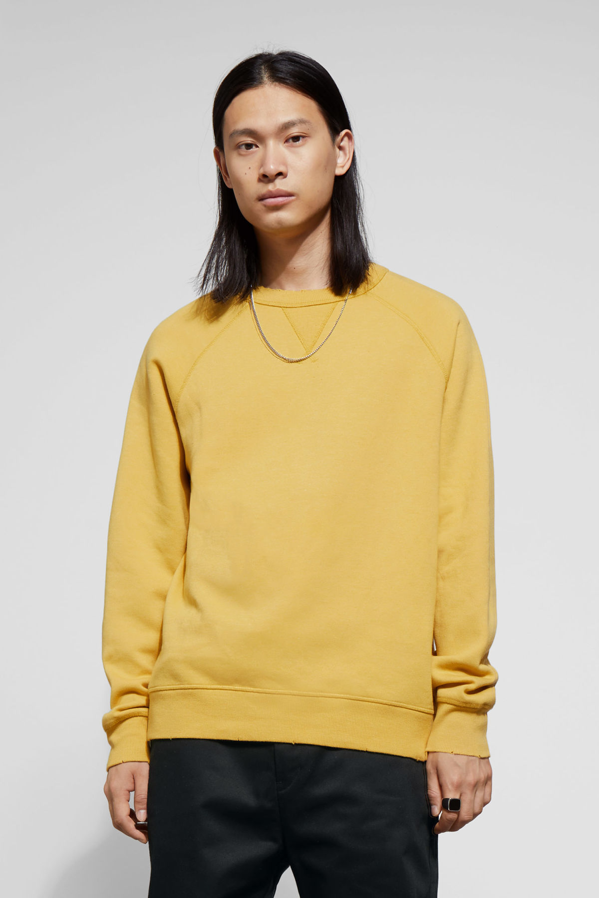 Model front image of Weekday jaxon washed sweatshirt in yellow