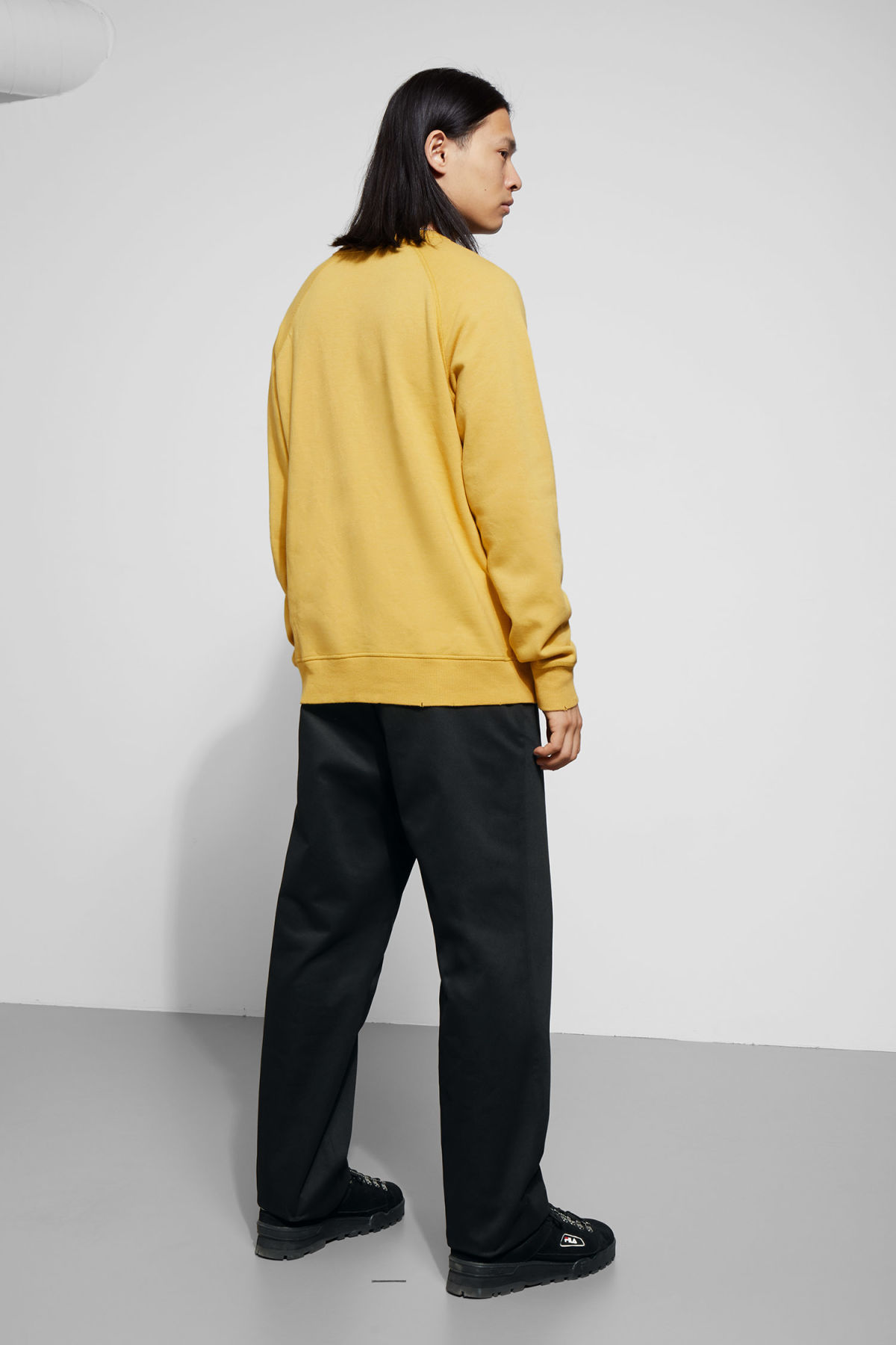 Model back image of Weekday jaxon washed sweatshirt in yellow