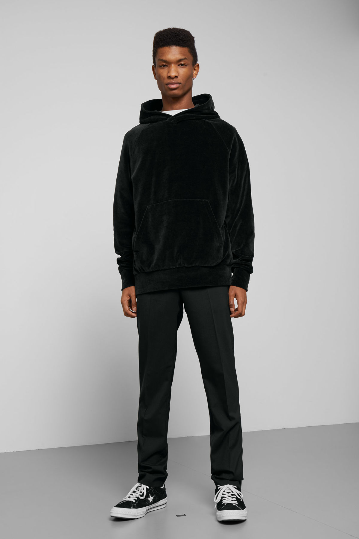 Model side image of Weekday magic velvet hoodie in black