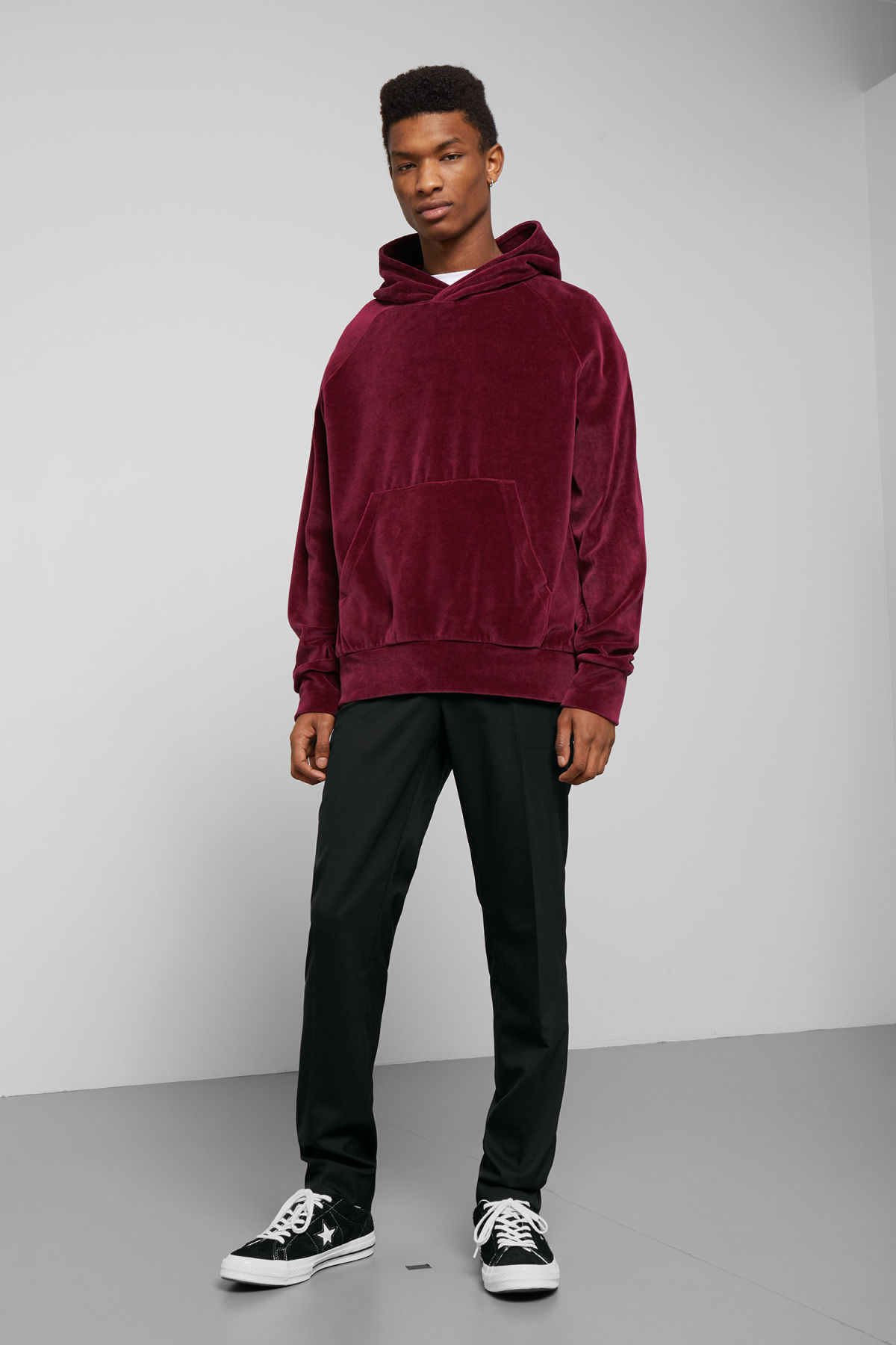 Model side image of Weekday magic velvet hoodie in red