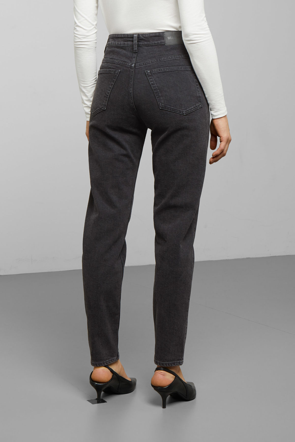 Model side image of Weekday lash echo black jeans in black