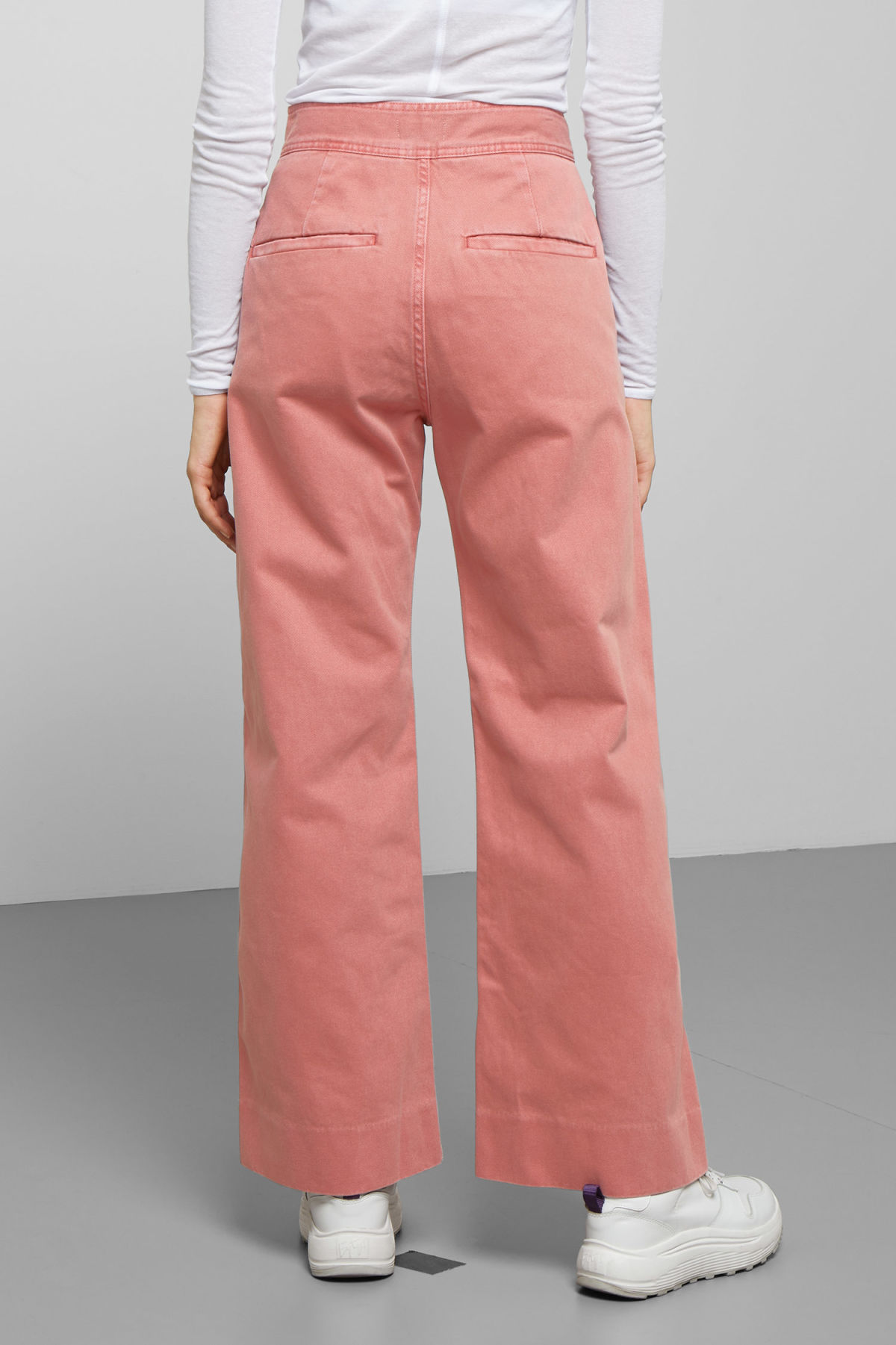 Model side image of Weekday cory rose denim trousers in orange