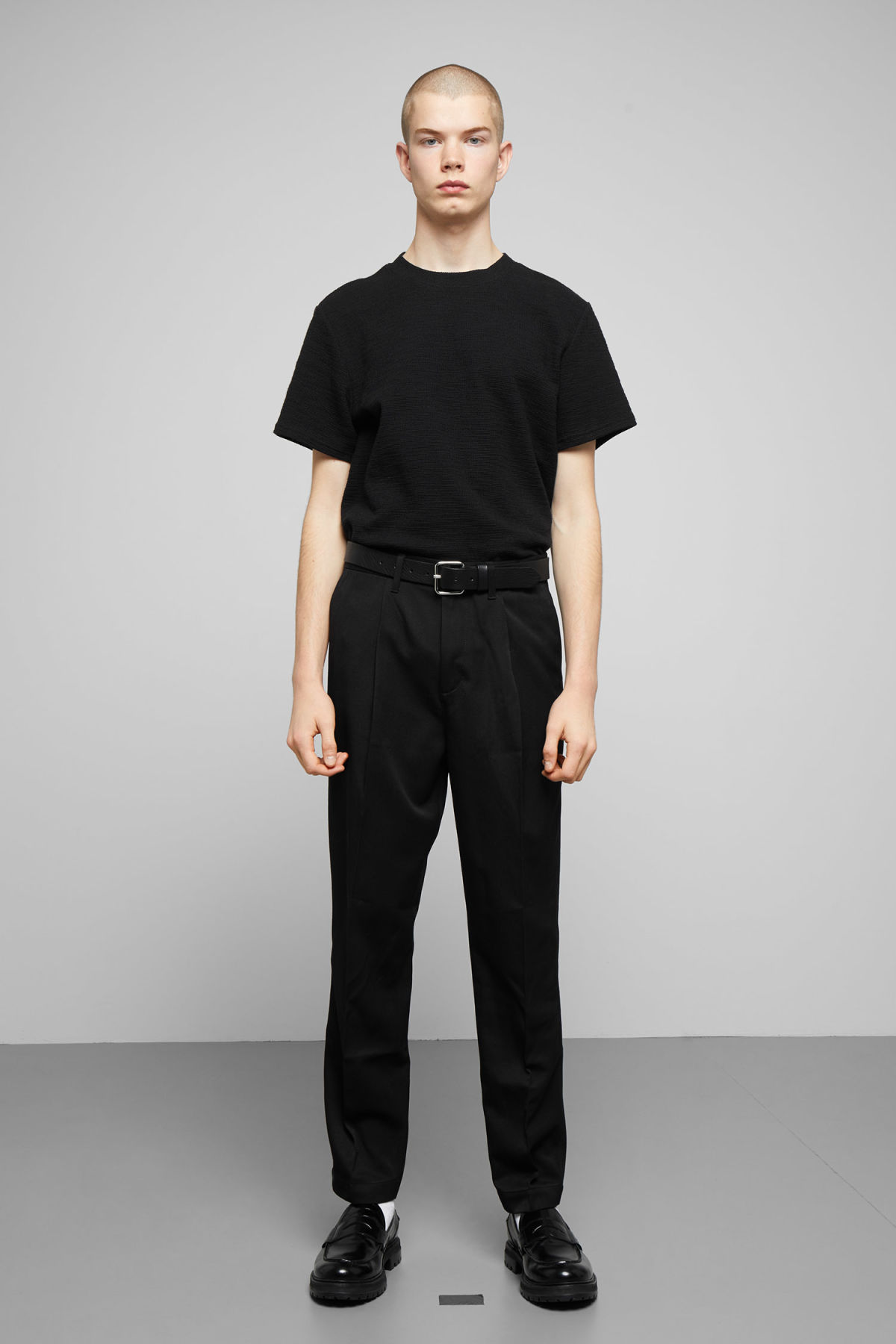 Model side image of Weekday bob structured t-shirt in black
