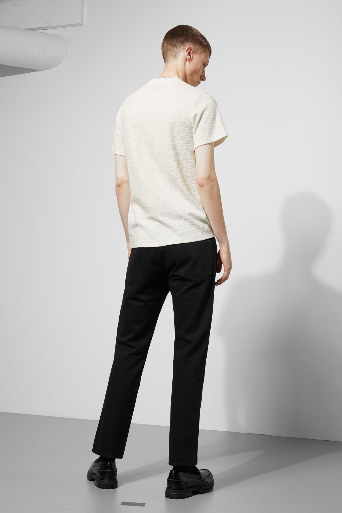 Model side image of Weekday bob structured t-shirt in white