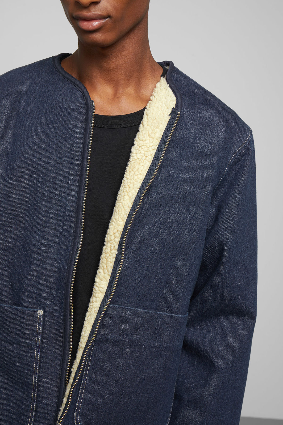 Model side image of Weekday harp blue rinsed jacket in blue