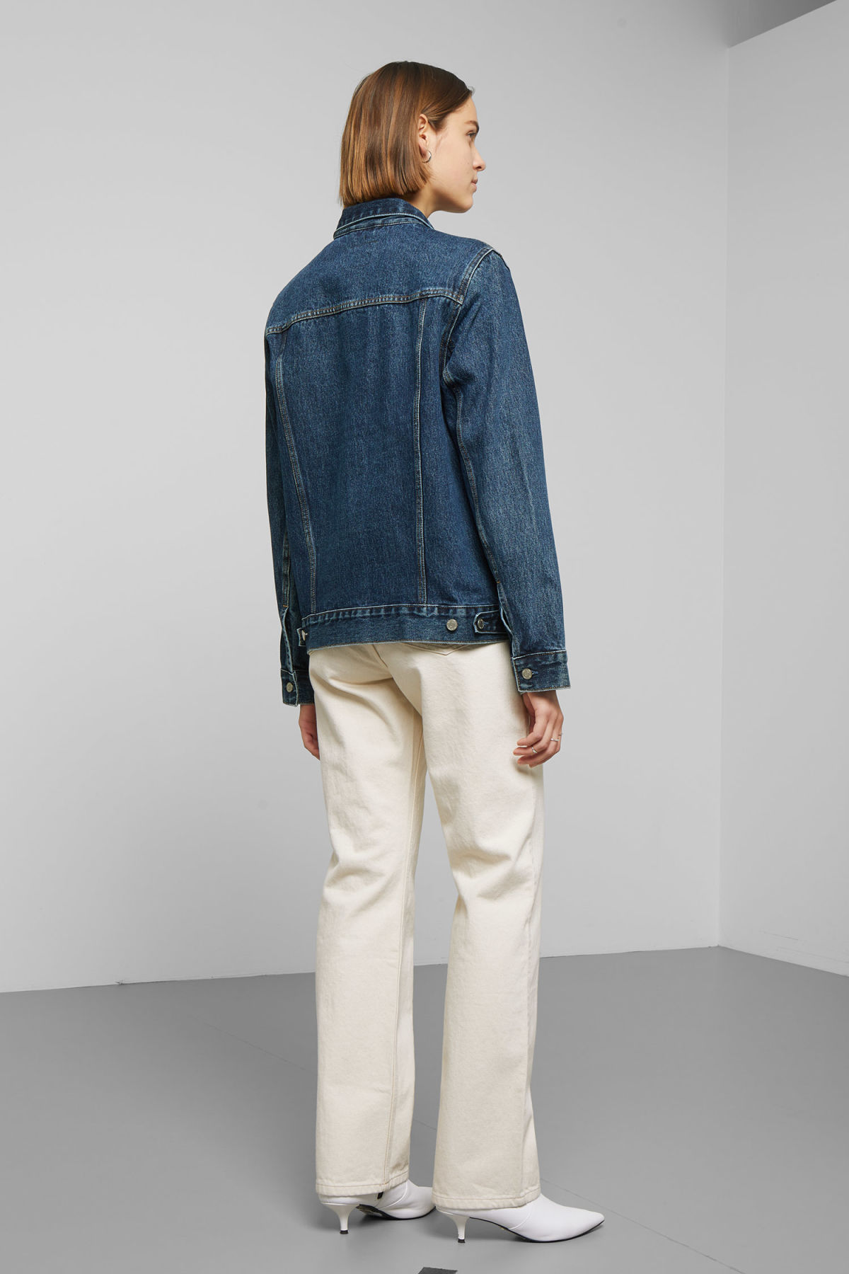 Model side image of Weekday core storm blue denim jacket in blue
