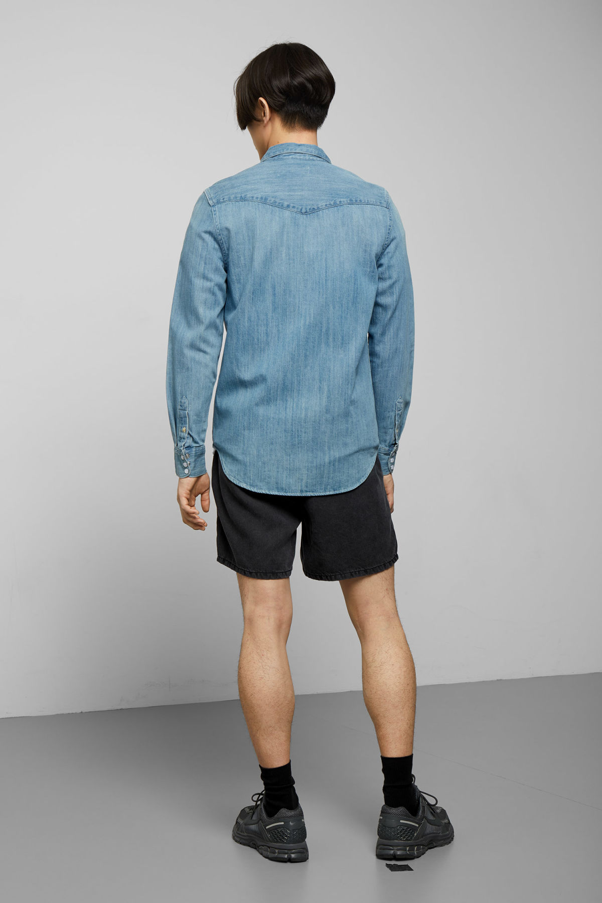 Model side image of Weekday lucky rodeo blue denim shirt in blue