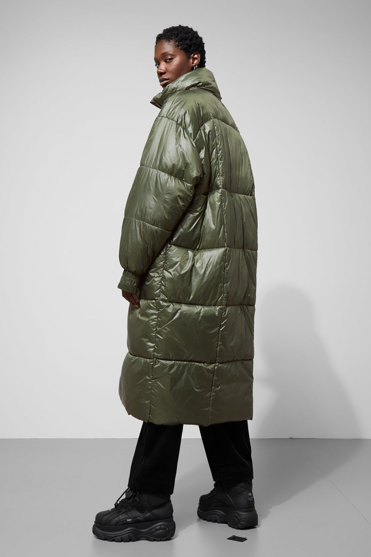 Model side image of Weekday awa puffer coat in green