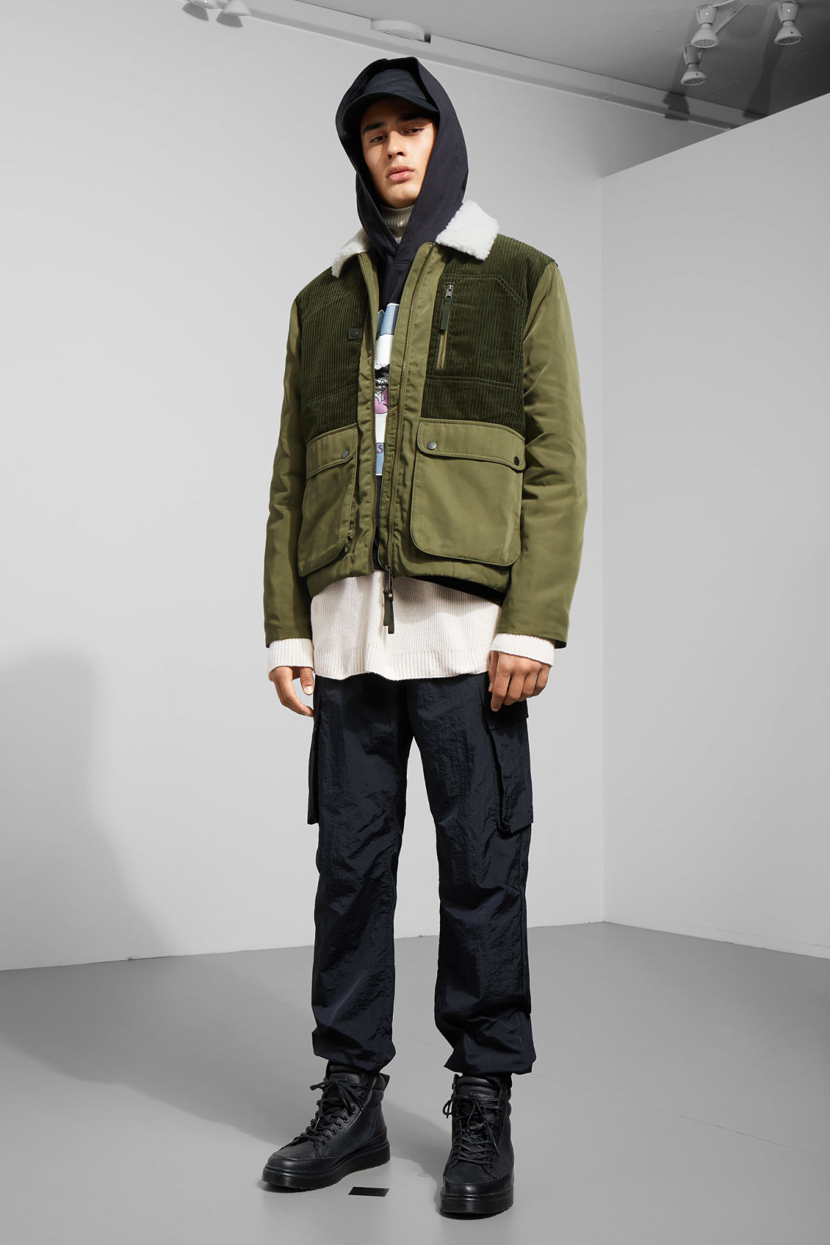 Model side image of Weekday barwa jacket in green