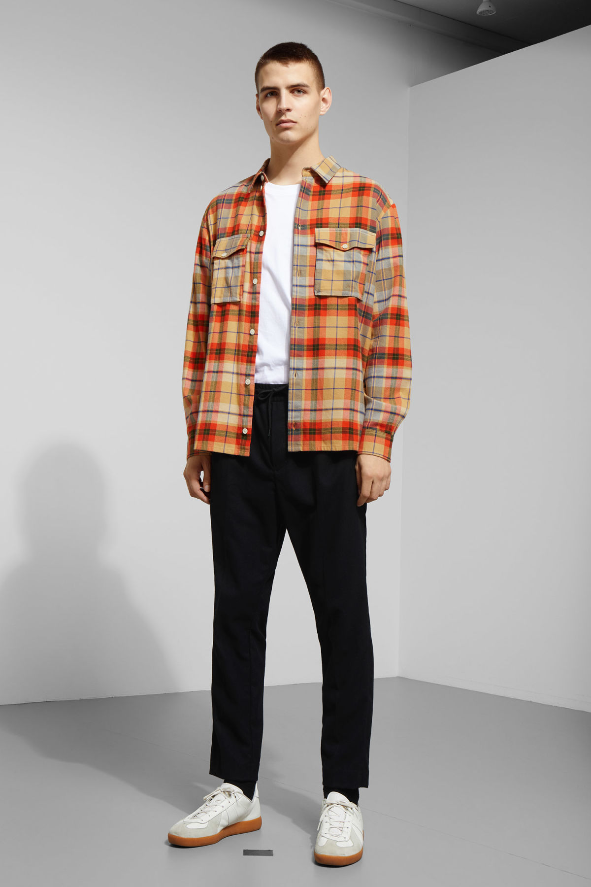 Model side image of Weekday kula checked shirt in beige