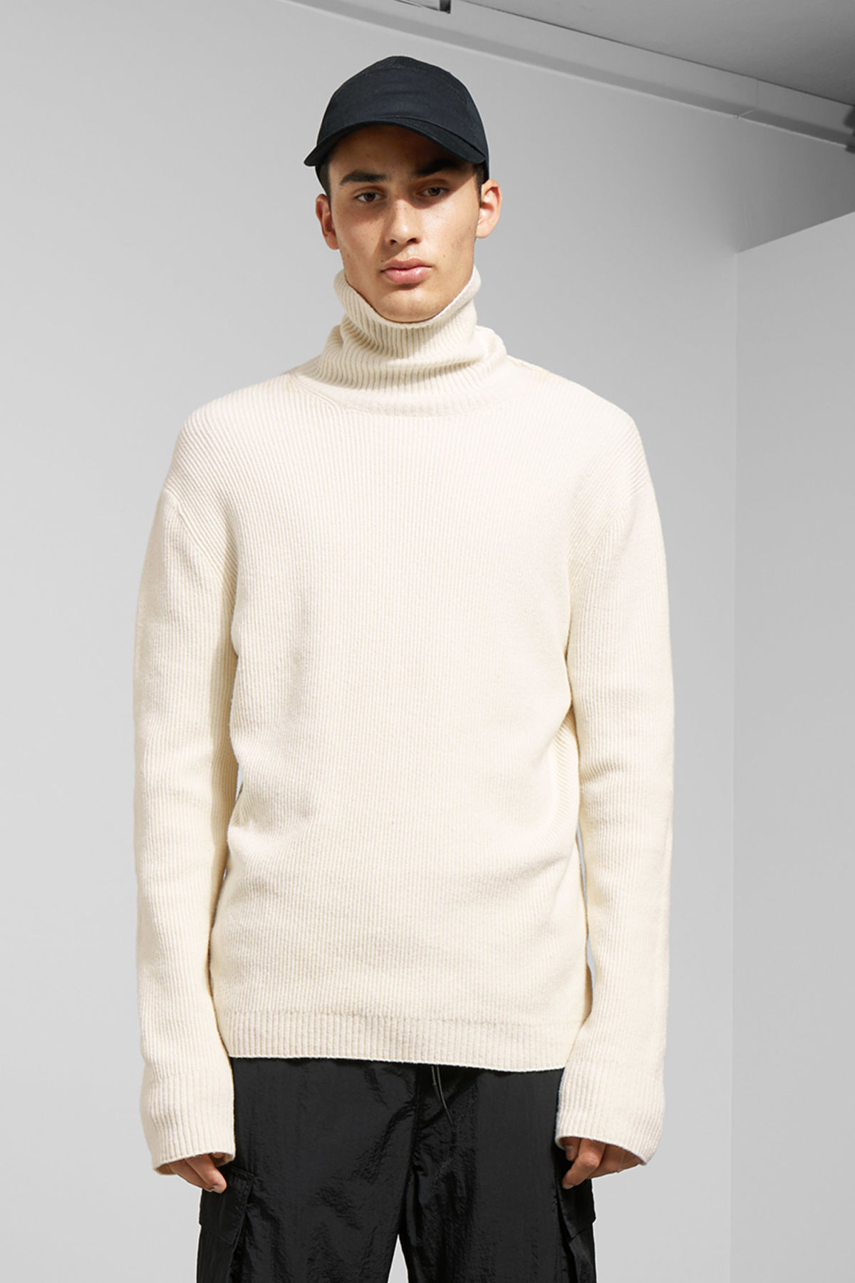Model front image of Weekday nuptse knitted turtleneck in beige