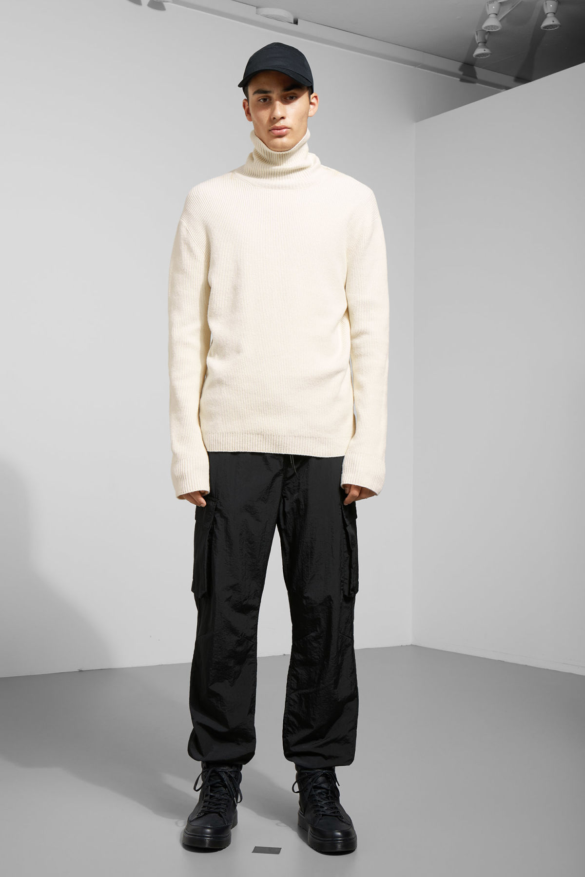 Model side image of Weekday nuptse knitted turtleneck in beige