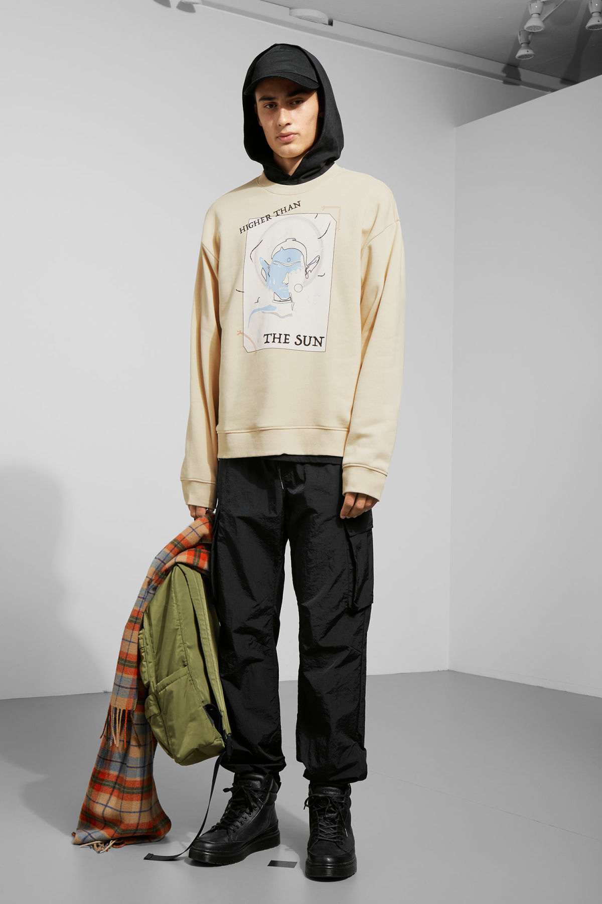 Model side image of Weekday pir higher sweatshirt in beige