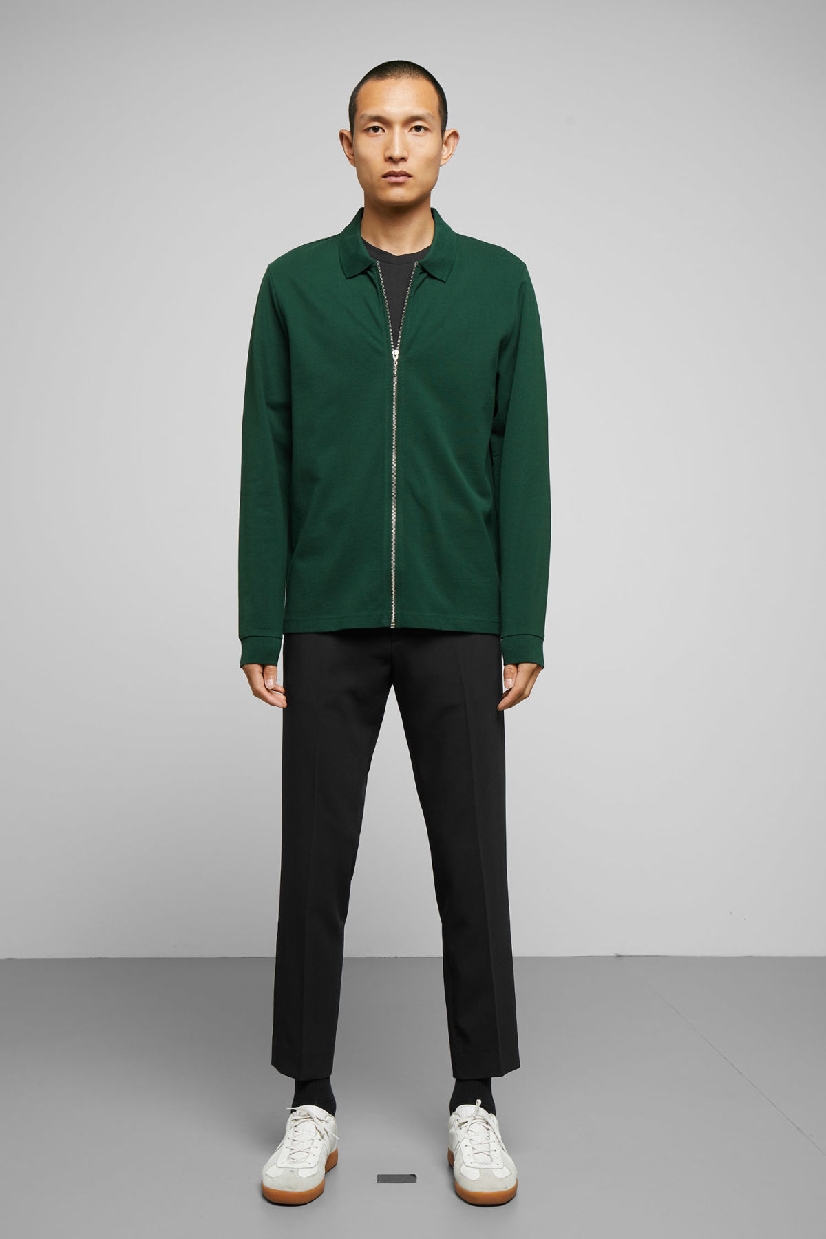 Model side image of Weekday lip zip long sleeve in green