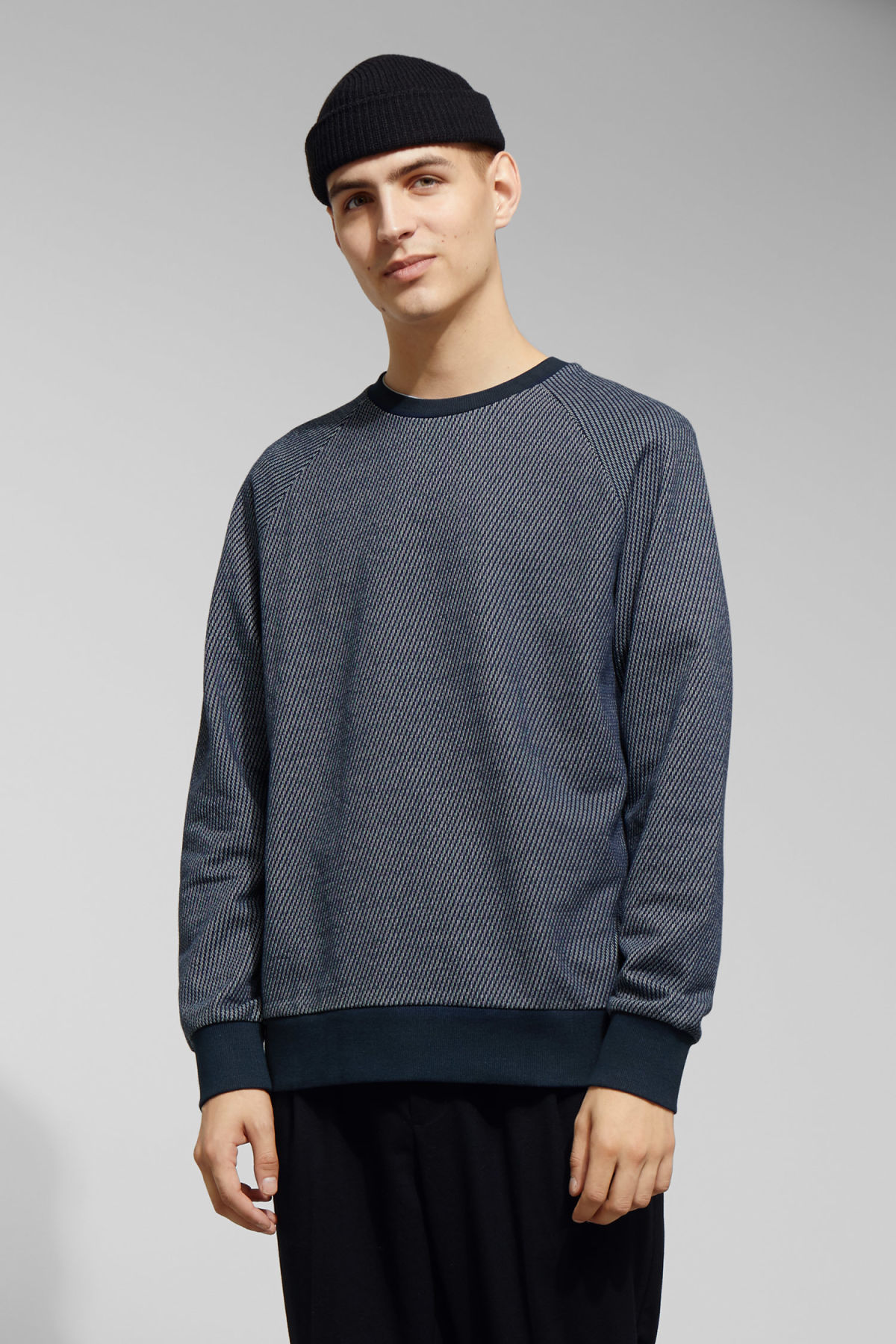 Model front image of Weekday paris structured sweatshirt in blue
