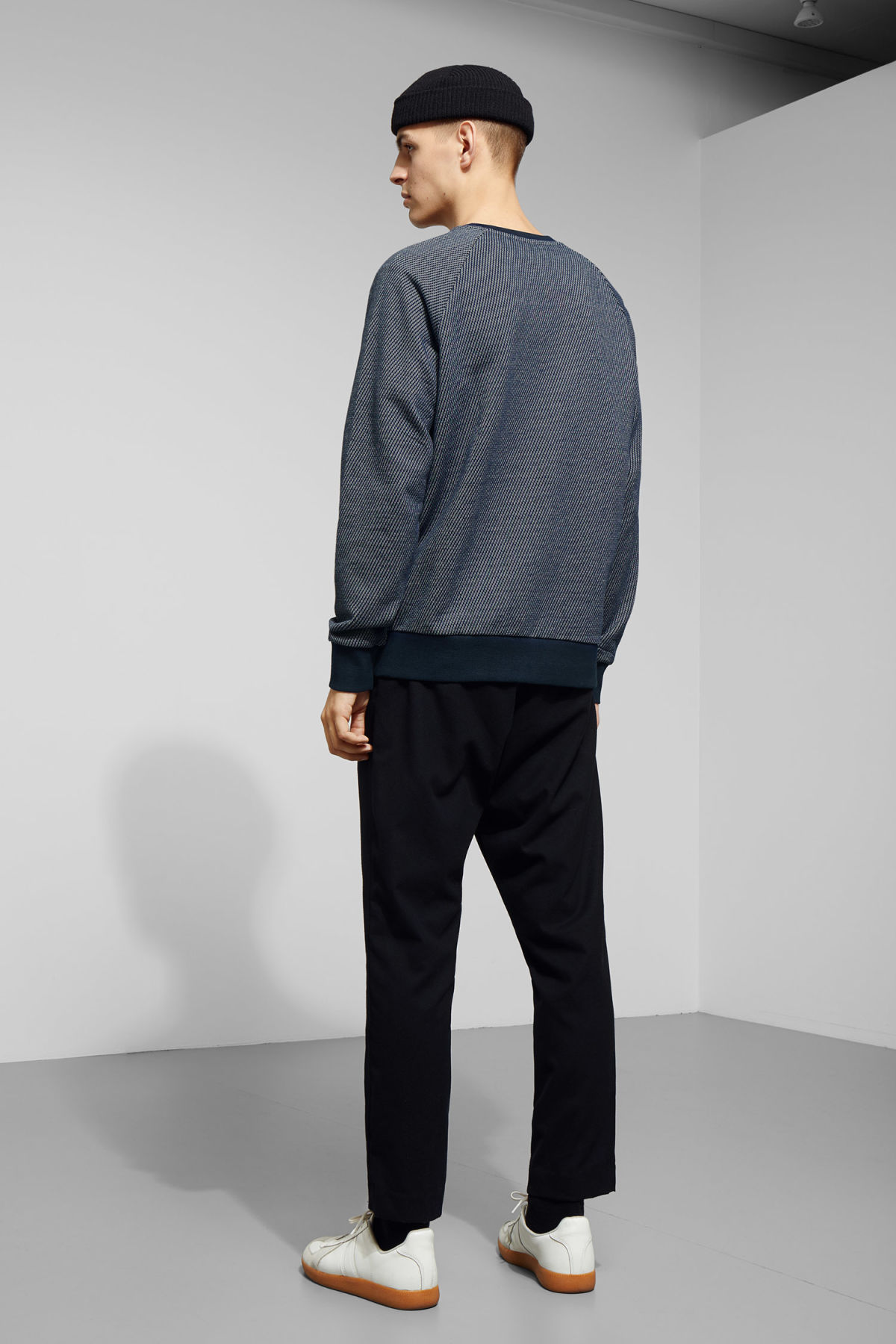 Model back image of Weekday paris structured sweatshirt in blue