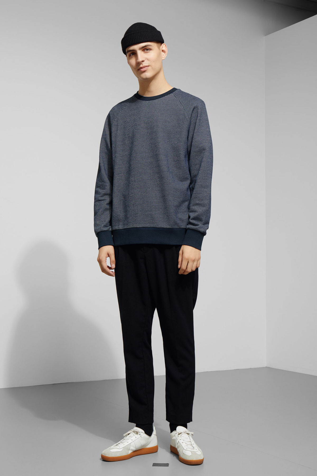 Model side image of Weekday paris structured sweatshirt in blue