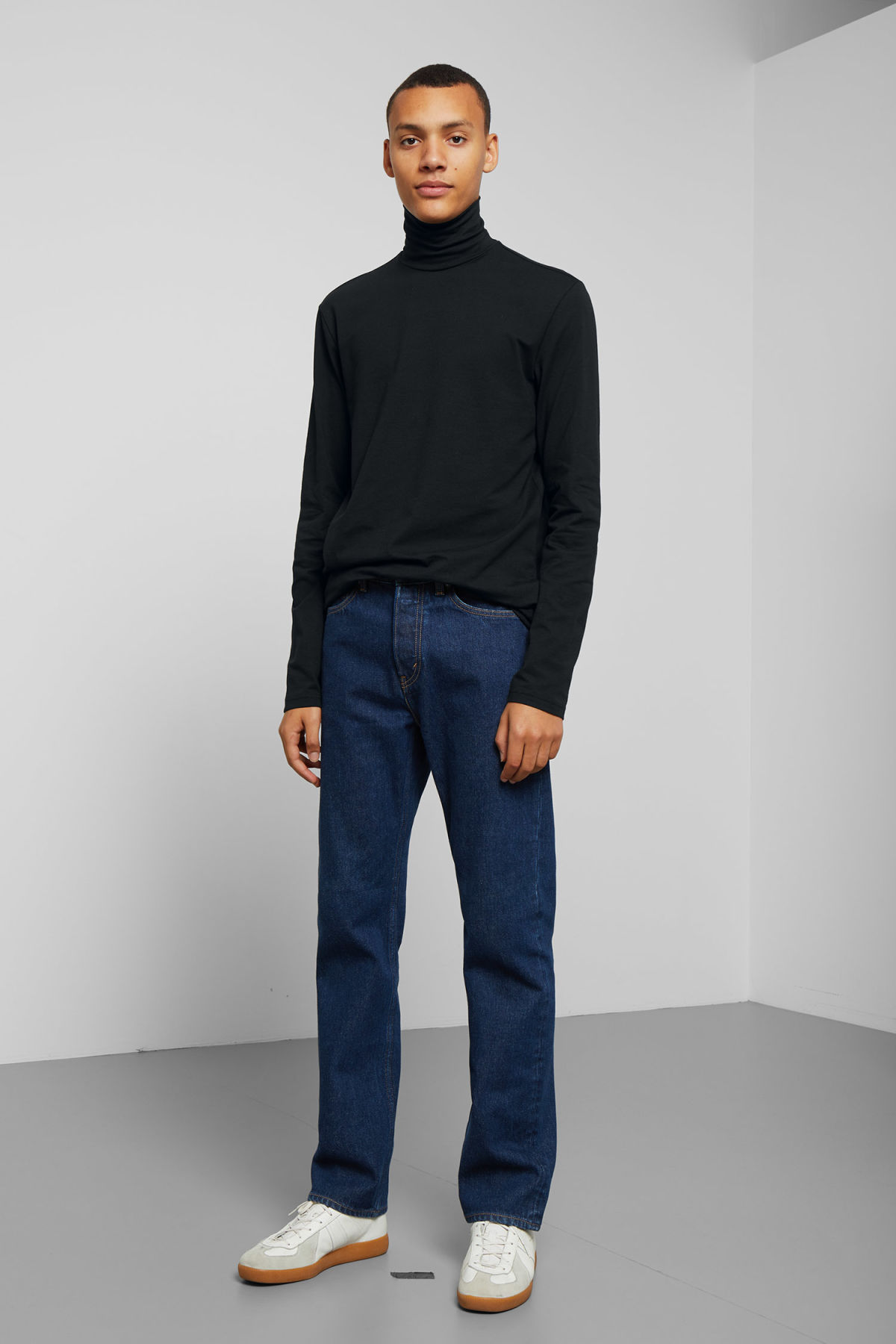 Model side image of Weekday ted turtleneck in black