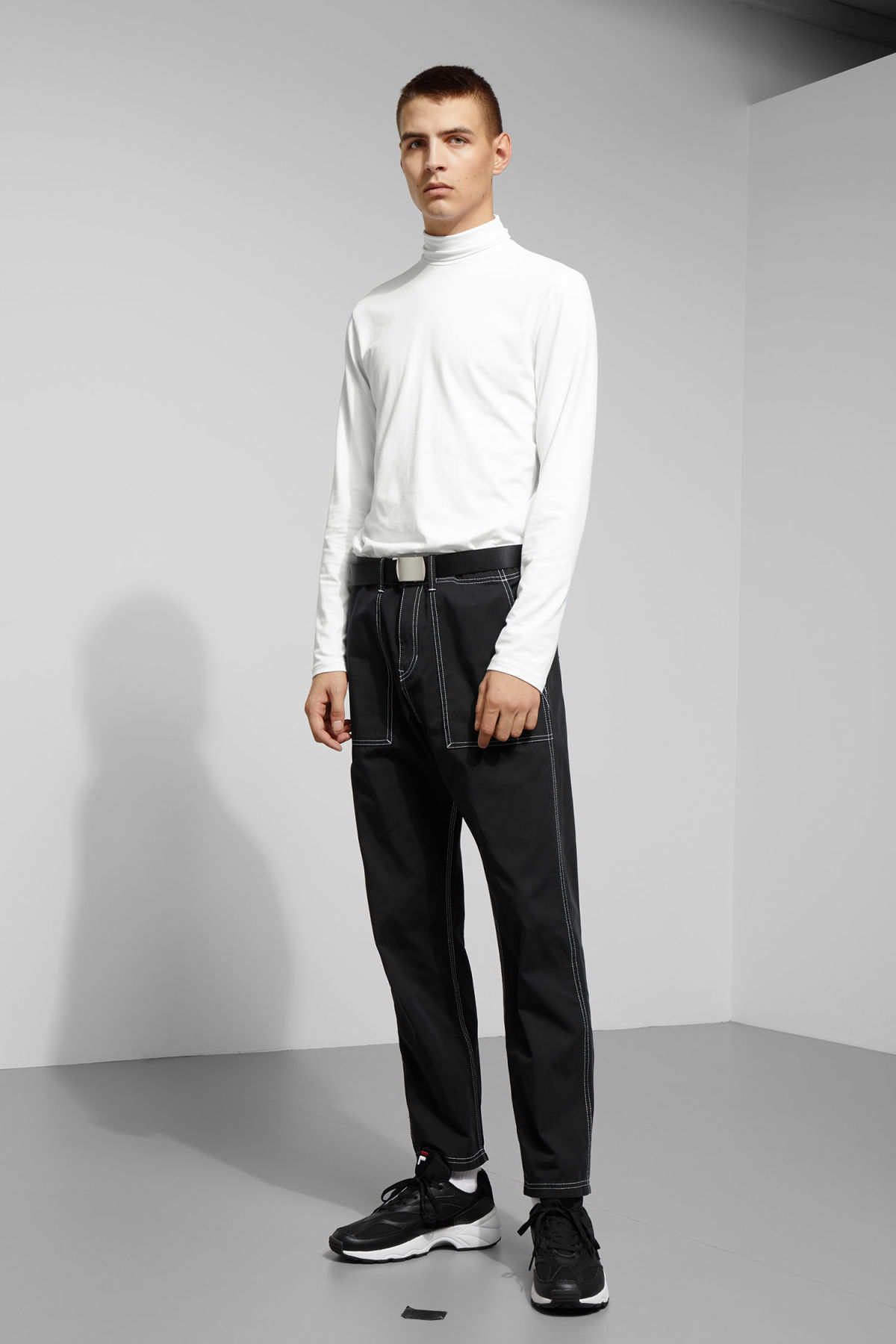 Model side image of Weekday ted turtleneck in white