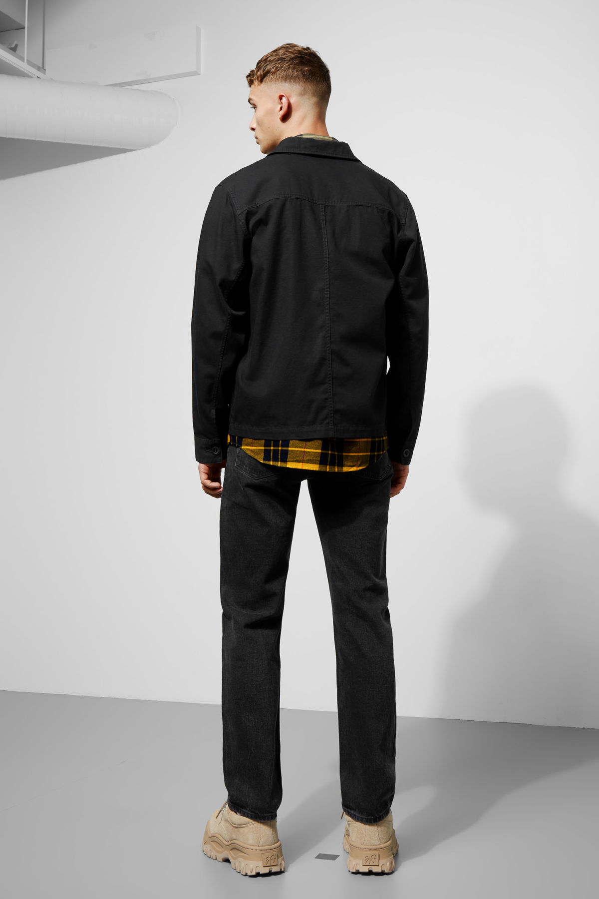 Model side image of Weekday lester overshirt in black