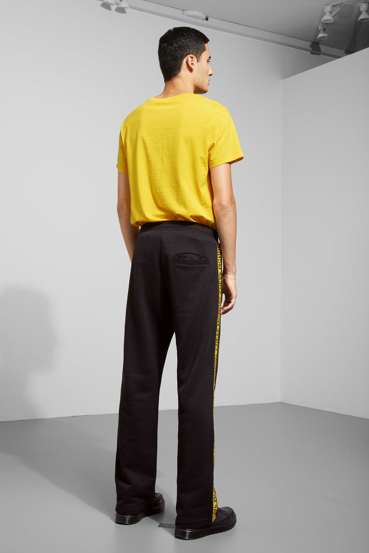 Model back image of Weekday fast logo trousers in black