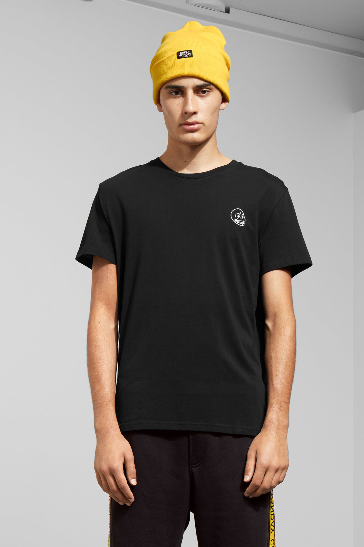 Model front image of Weekday standard tiny skull t-shirt  in black