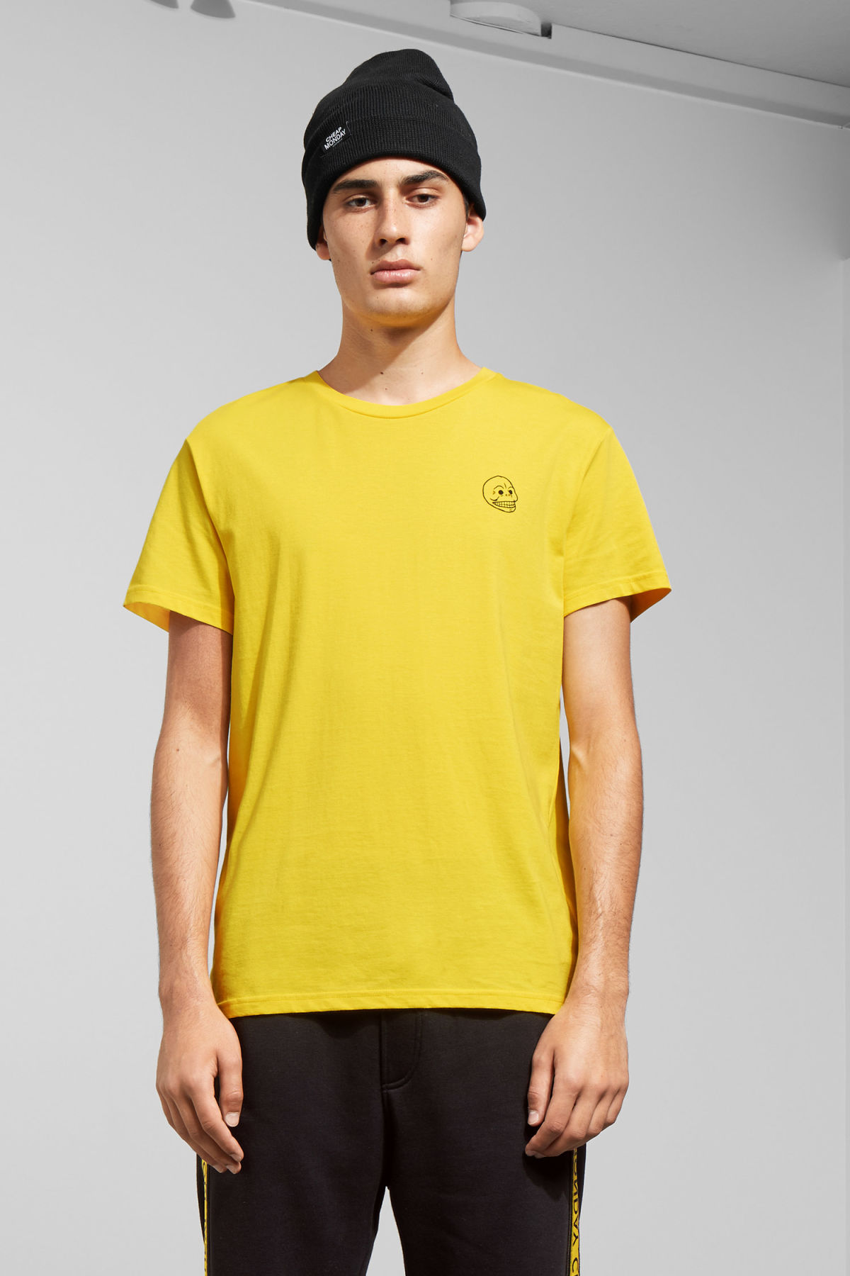 Model front image of Weekday standard tiny skull t-shirt  in yellow