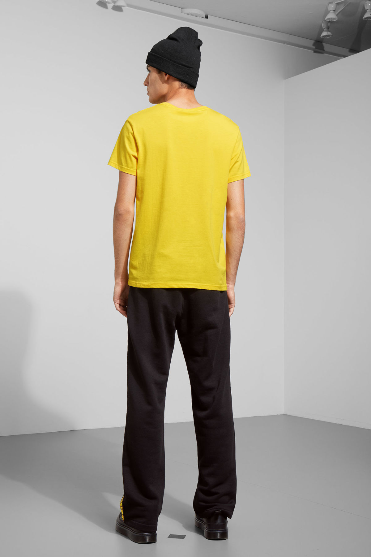 Model back image of Weekday standard tiny skull t-shirt  in yellow