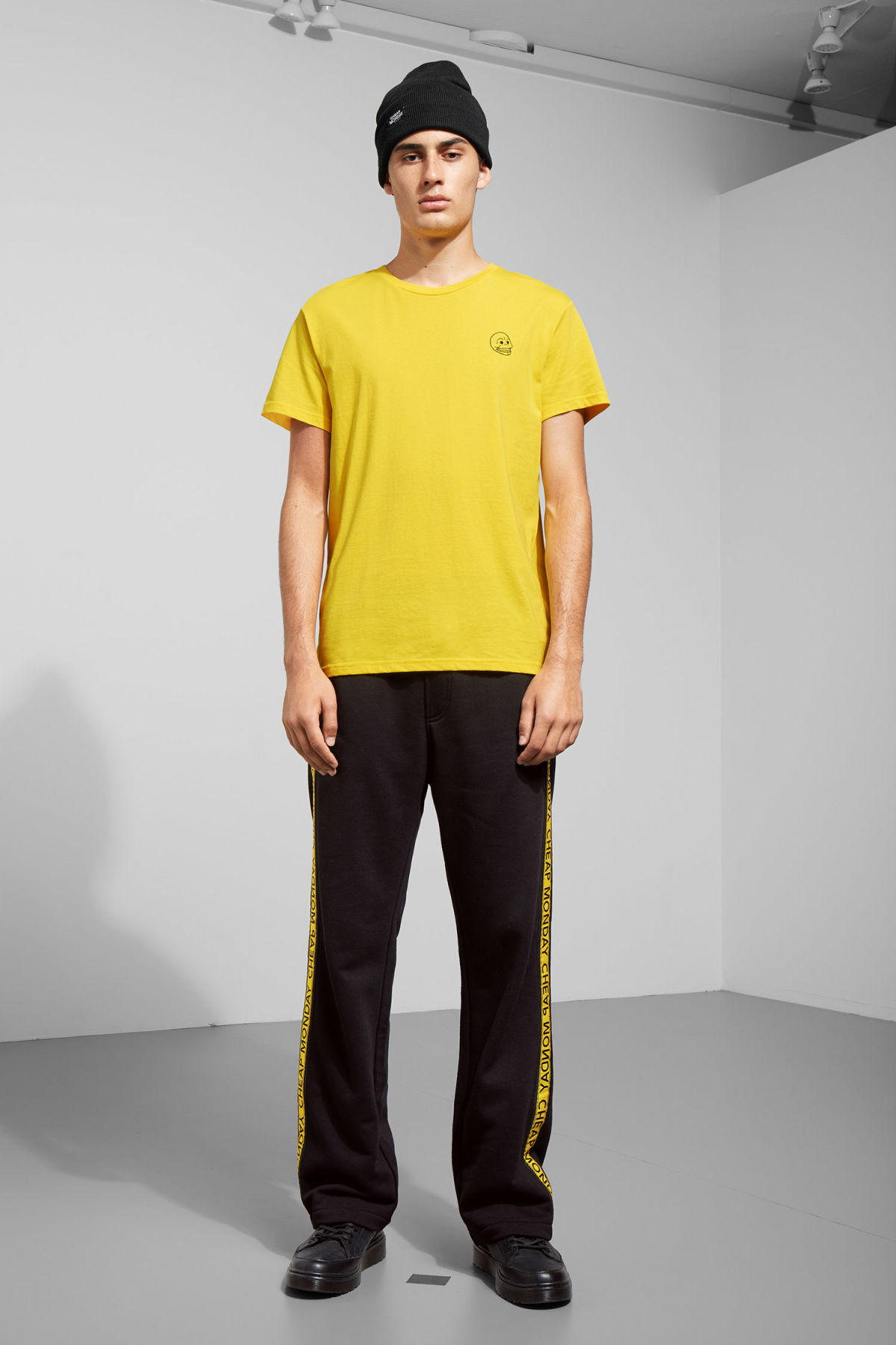 Model side image of Weekday standard tiny skull t-shirt  in yellow