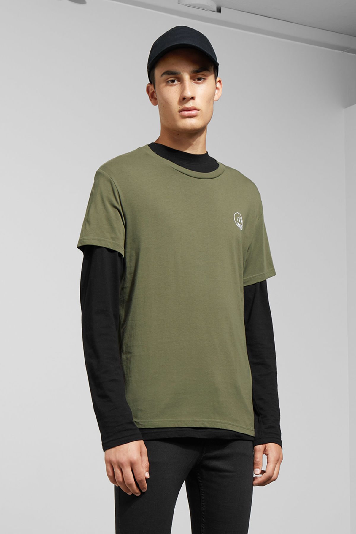 Model front image of Weekday standard tiny skull t-shirt  in green