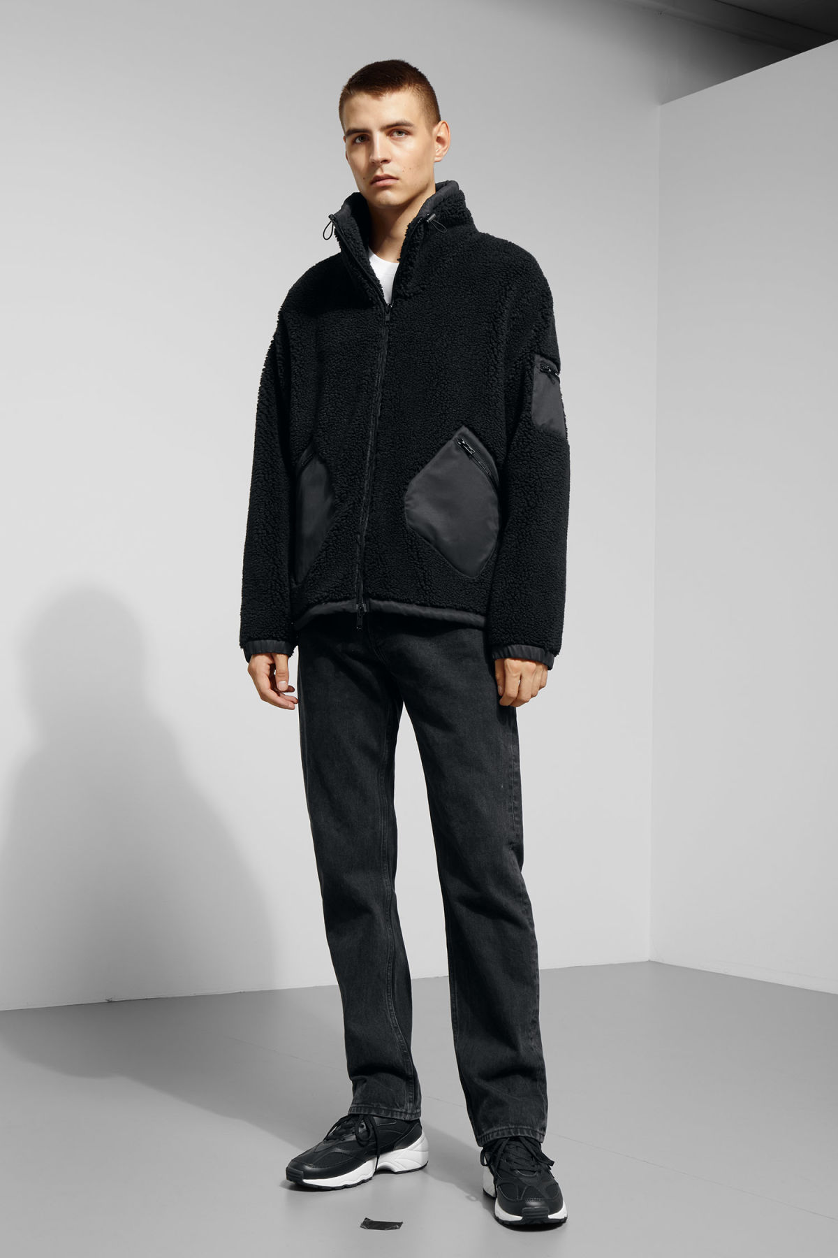 Model side image of Weekday hick pile jacket in black