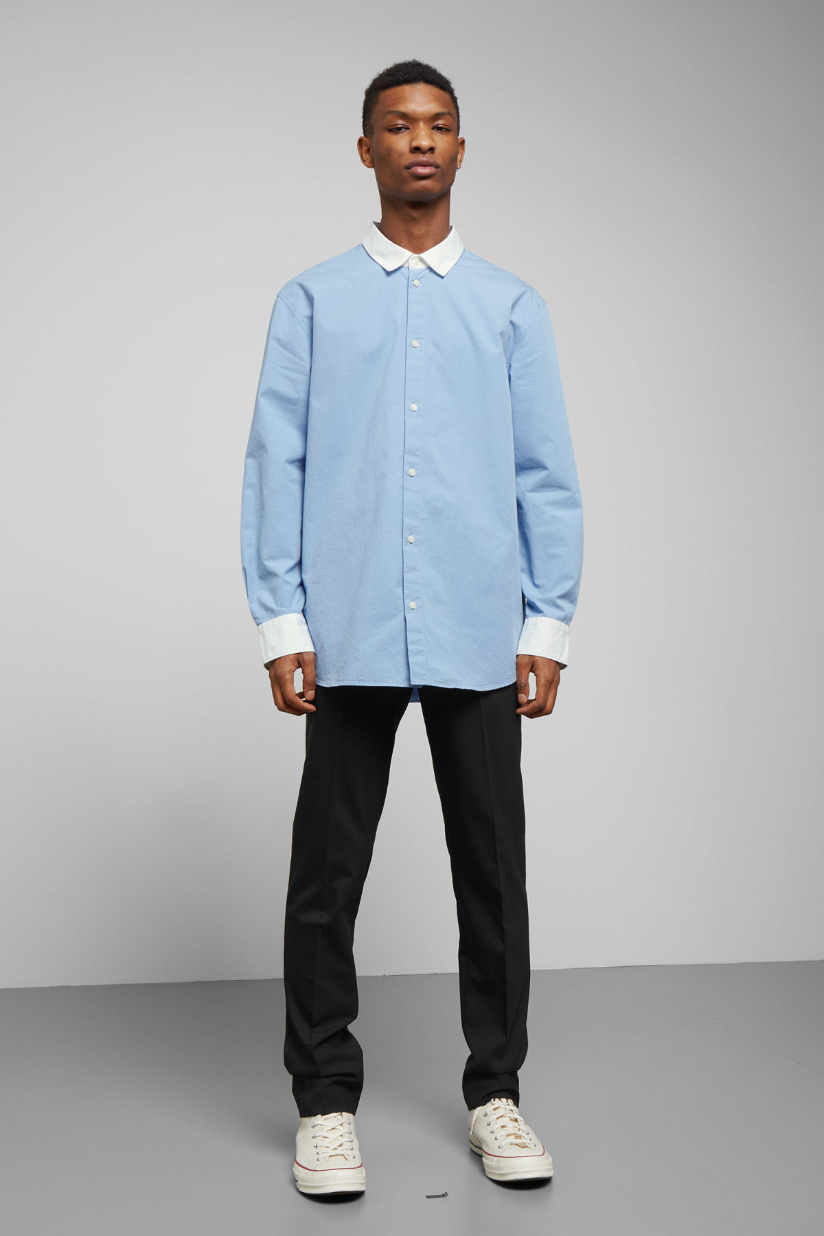 Model side image of Weekday stan shirt in blue