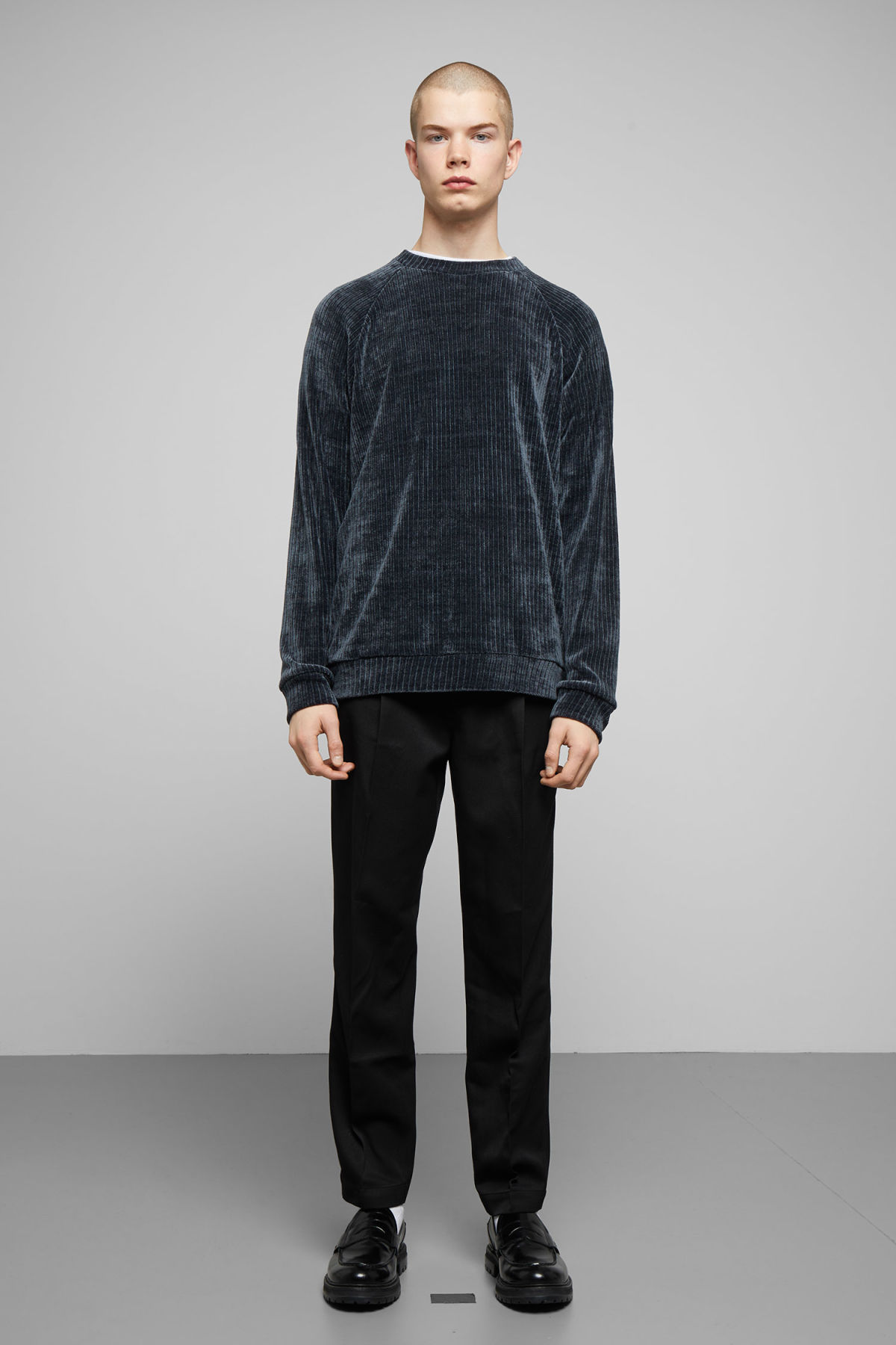 Model side image of Weekday curt structure sweatshirt in blue