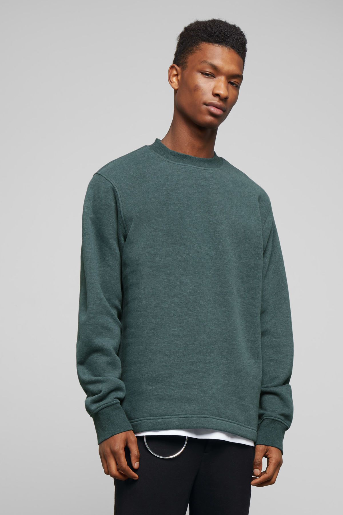 Model front image of Weekday score sweatshirt in turquoise