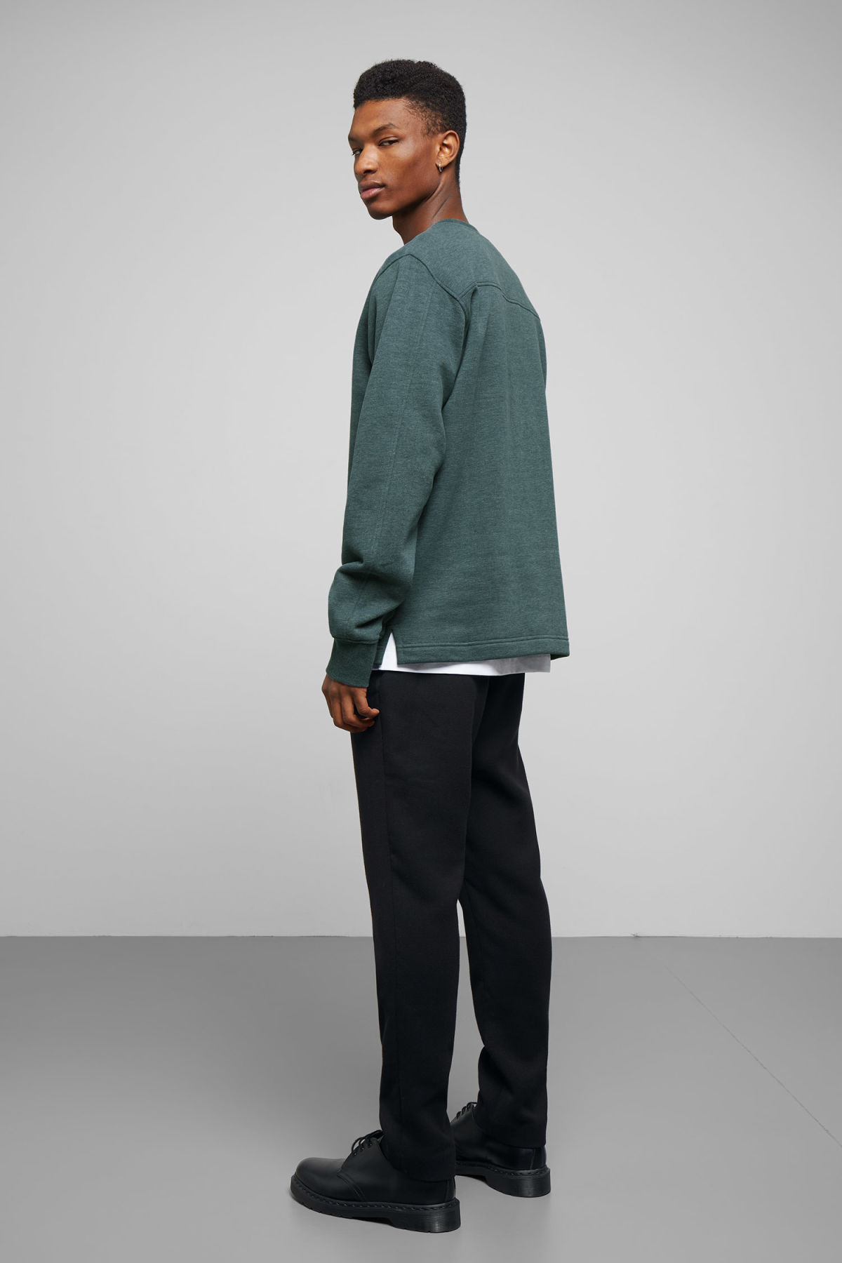 Model side image of Weekday score sweatshirt in turquoise