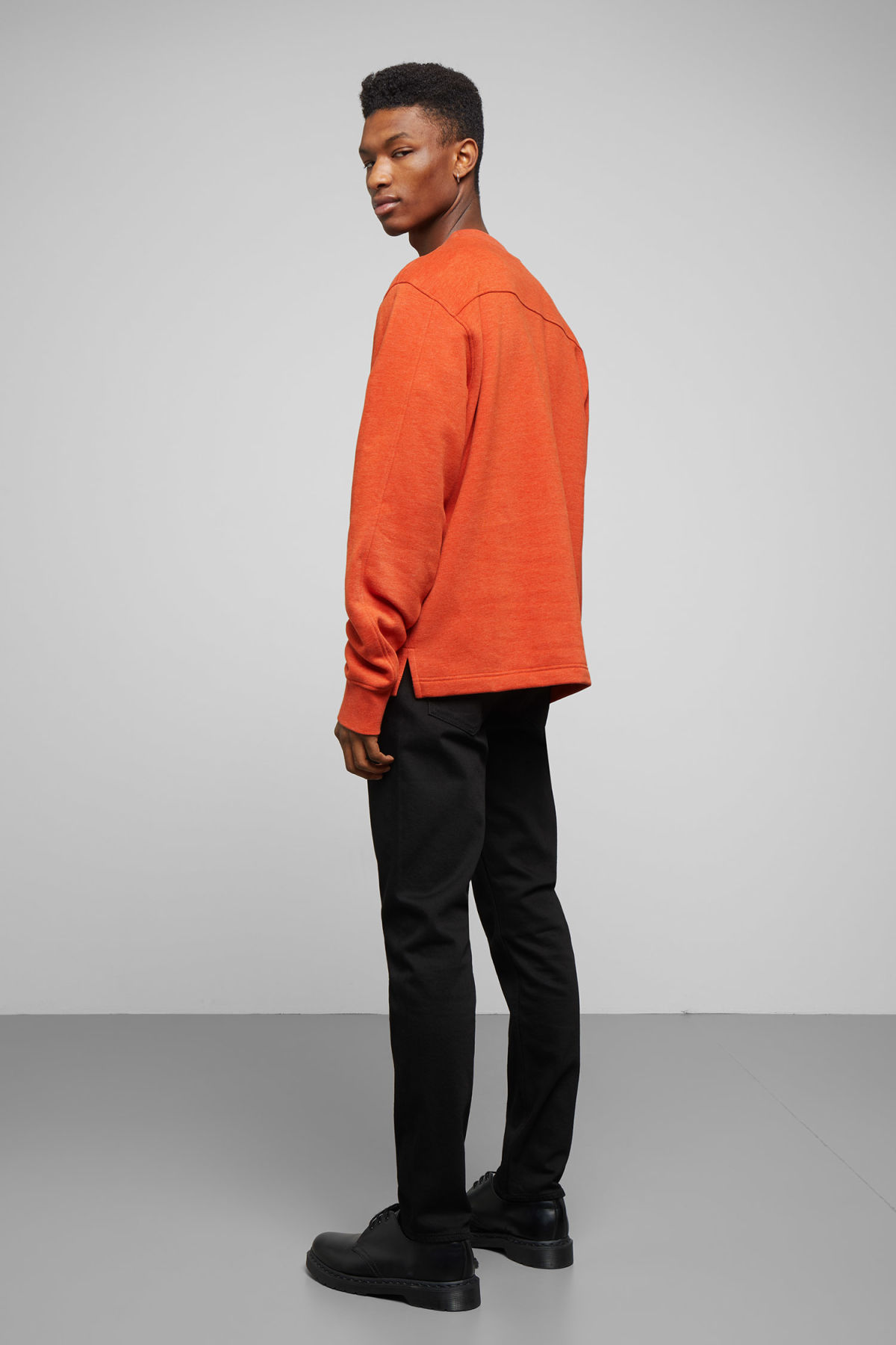 Model side image of Weekday score sweatshirt in orange