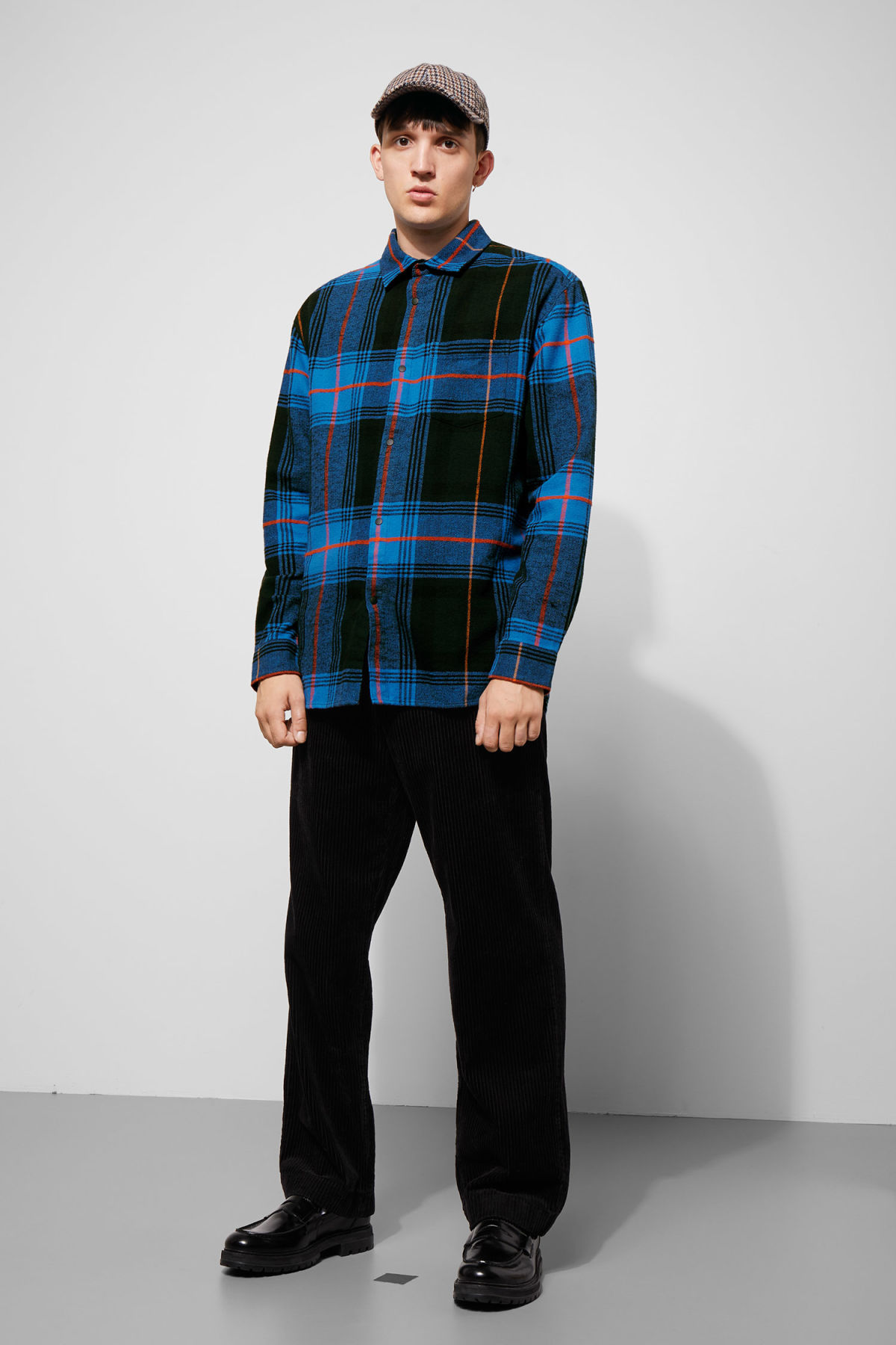 Model side image of Weekday lumber herringbone shirt in blue